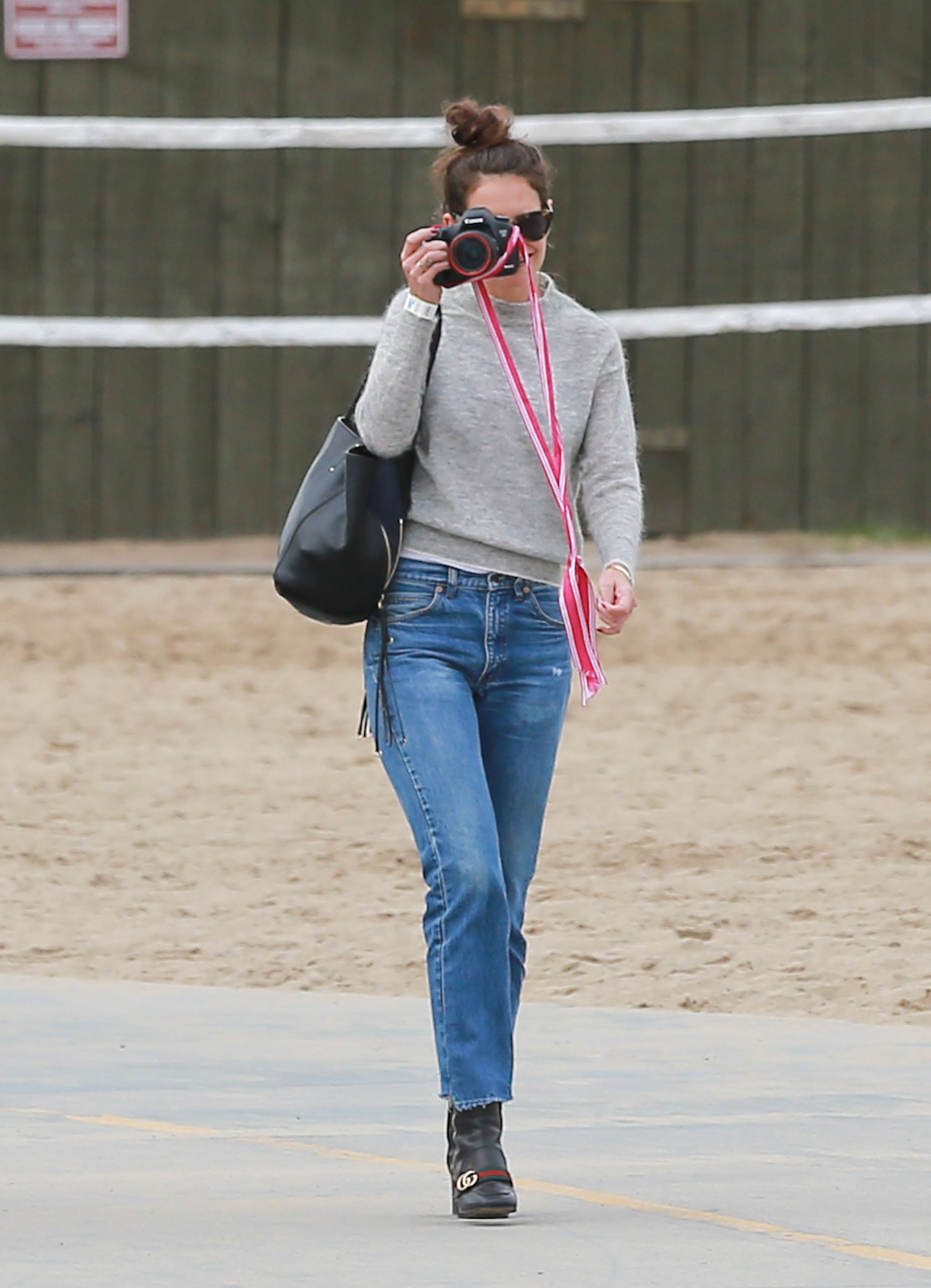 EXCLUSIVE Katie Holmes Snaps Away While Enjoying A Fun Family Day With Suri And Her Nephews