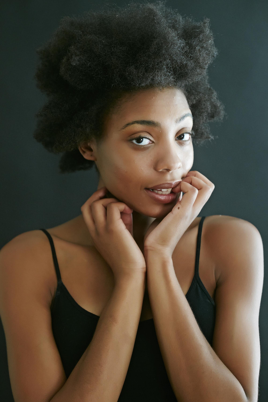 Close up of black woman biting fingernails