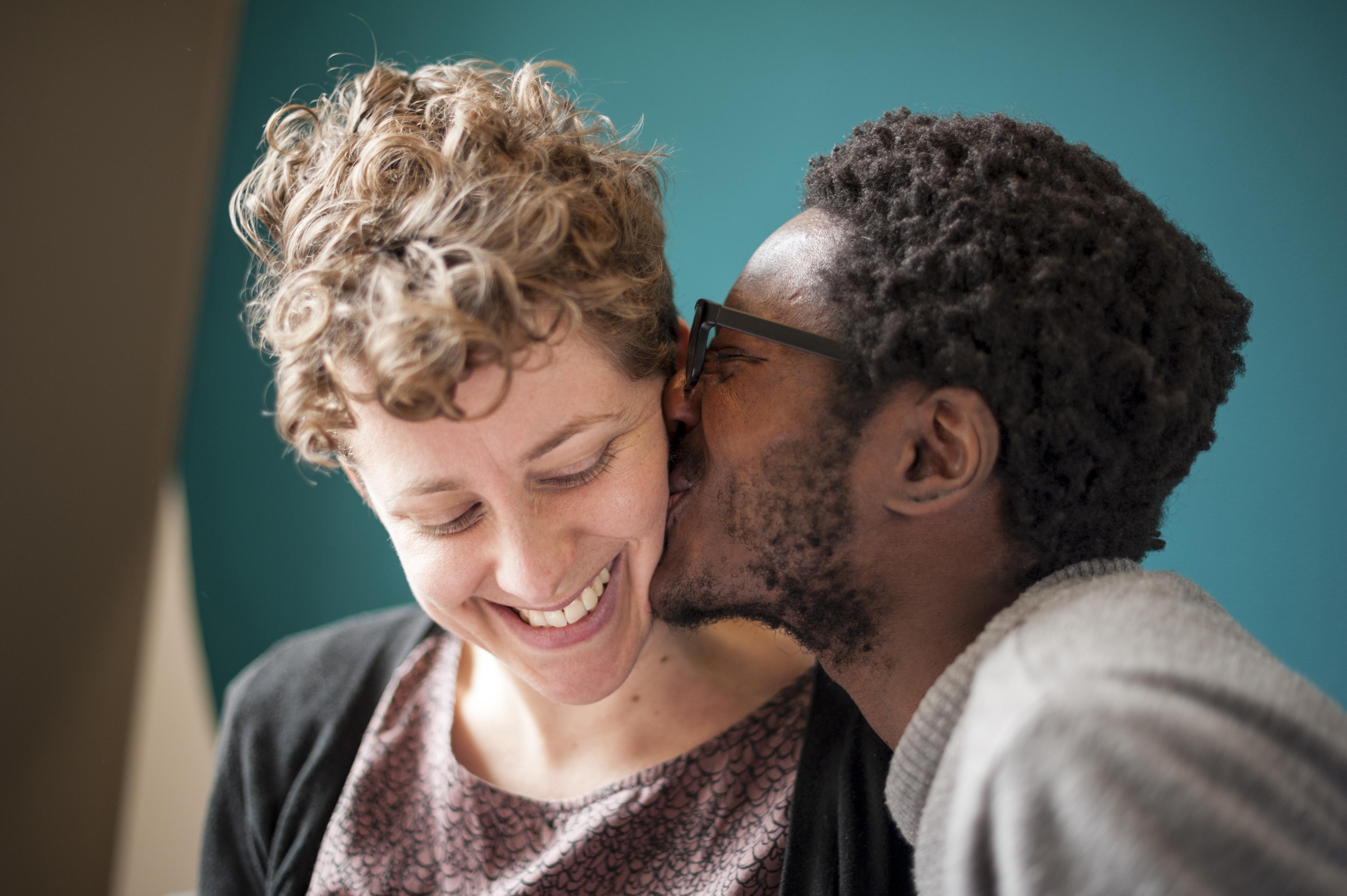 Man kissing his girlfriend