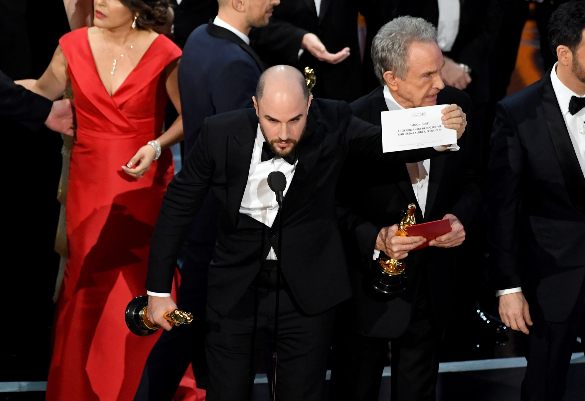 HOLLYWOOD, CA - FEBRUARY 26: 'La La Land' producer Jordan Horowitz holds up the winner card reading actual Best Picture winner 'Moonlight' with actor Warren Beatty onstage during the 89th Annual Academy Awards at Hollywood & Highland Center on February 26, 2017 in Hollywood, California. (Photo by Kevin Winter/Getty Images)