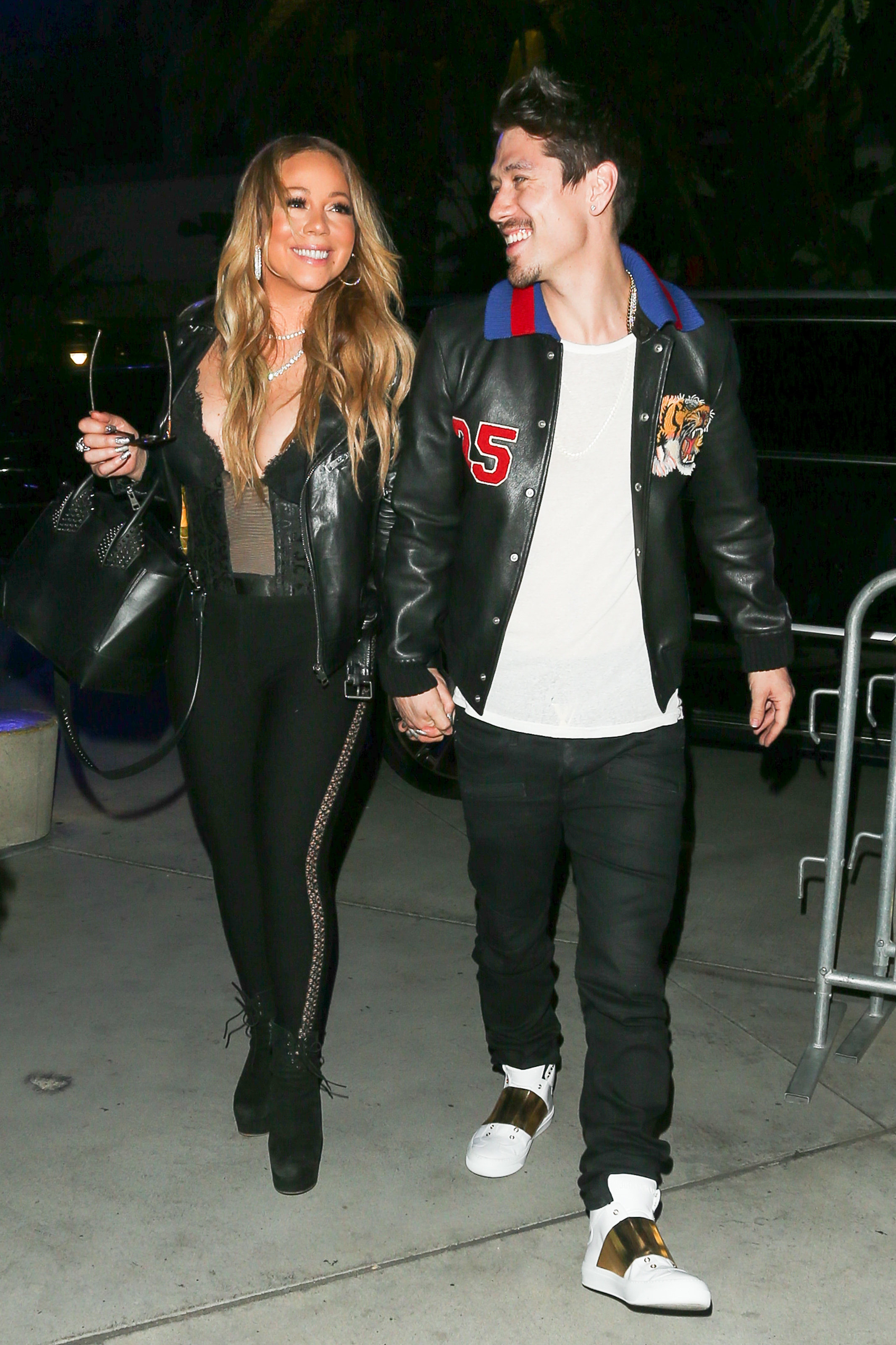 Mariah Carey Shows Off Her Cleavage While Holding Hands With her new flame Bryan Tanaka