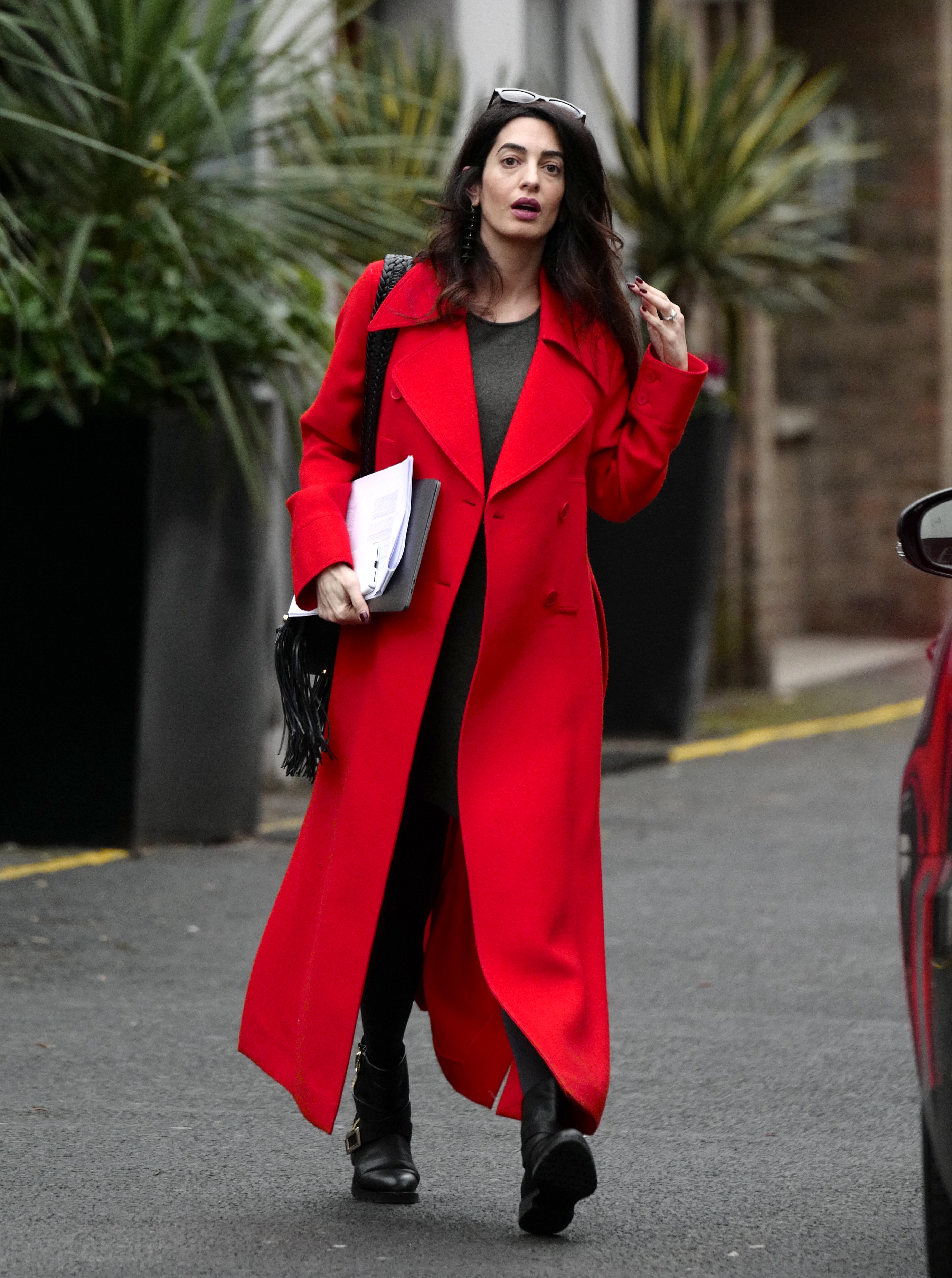 EXCLUSIVE Amal Clooney Reveals a Hint of her Baby Bump Under Red Coat