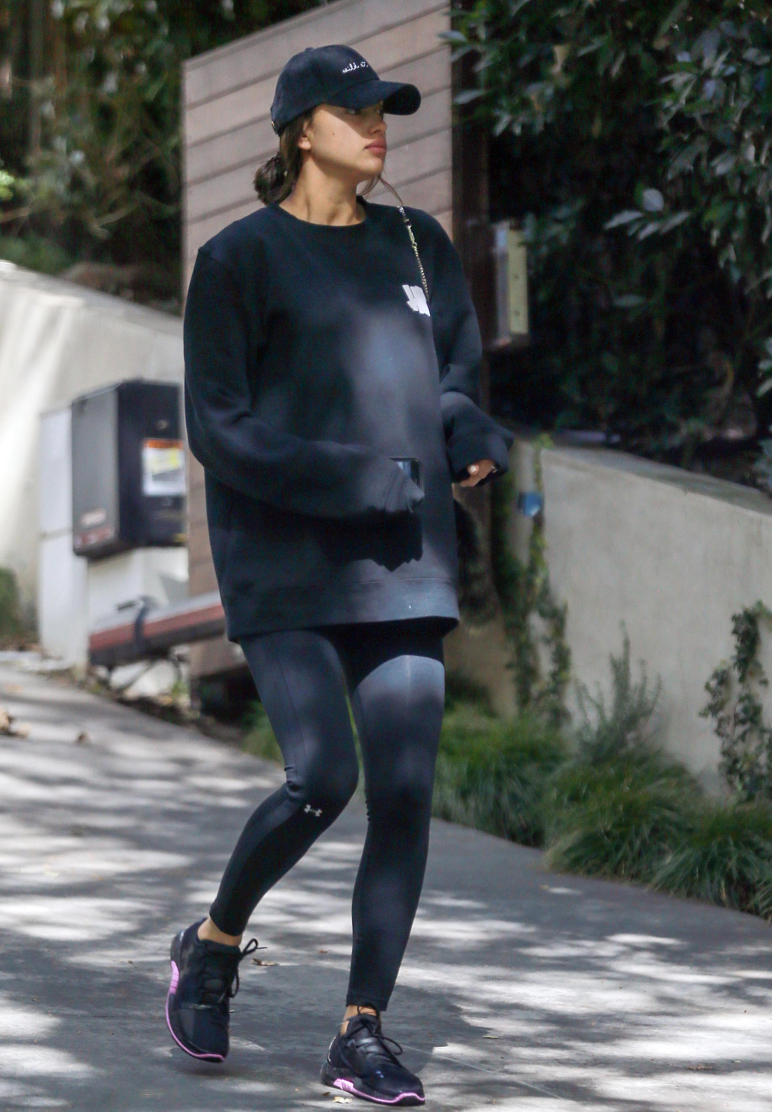 EXCLUSIVE Irina Shayk Covers Up her Growing Baby Bump as she Hits the Gym in LA