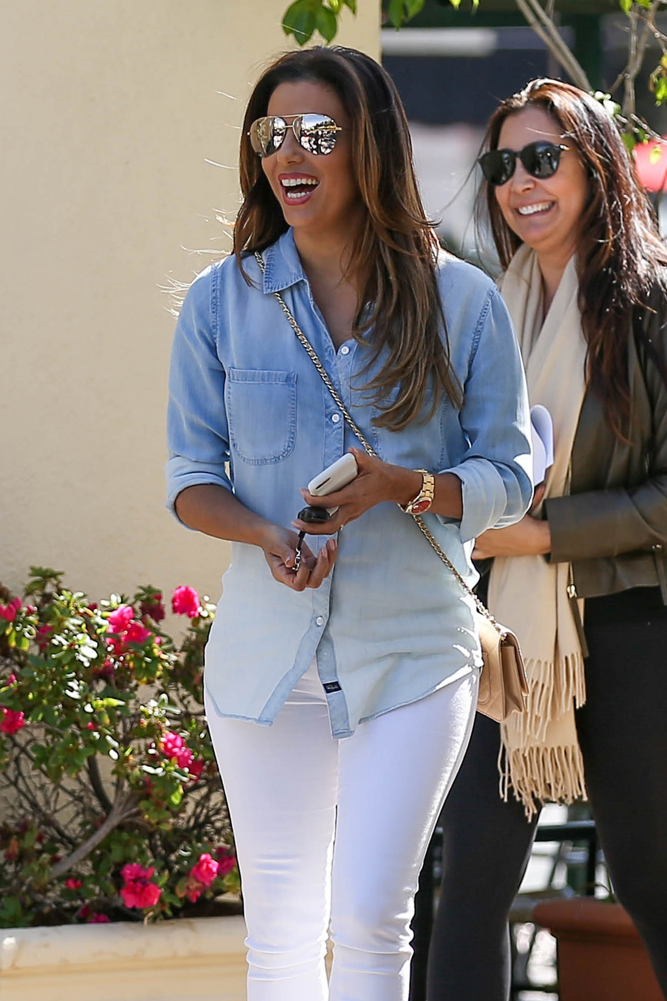Eva Longoria Cuts A Chic Figure In Ombre Denim Shirt And White Pants For Girls Lunch