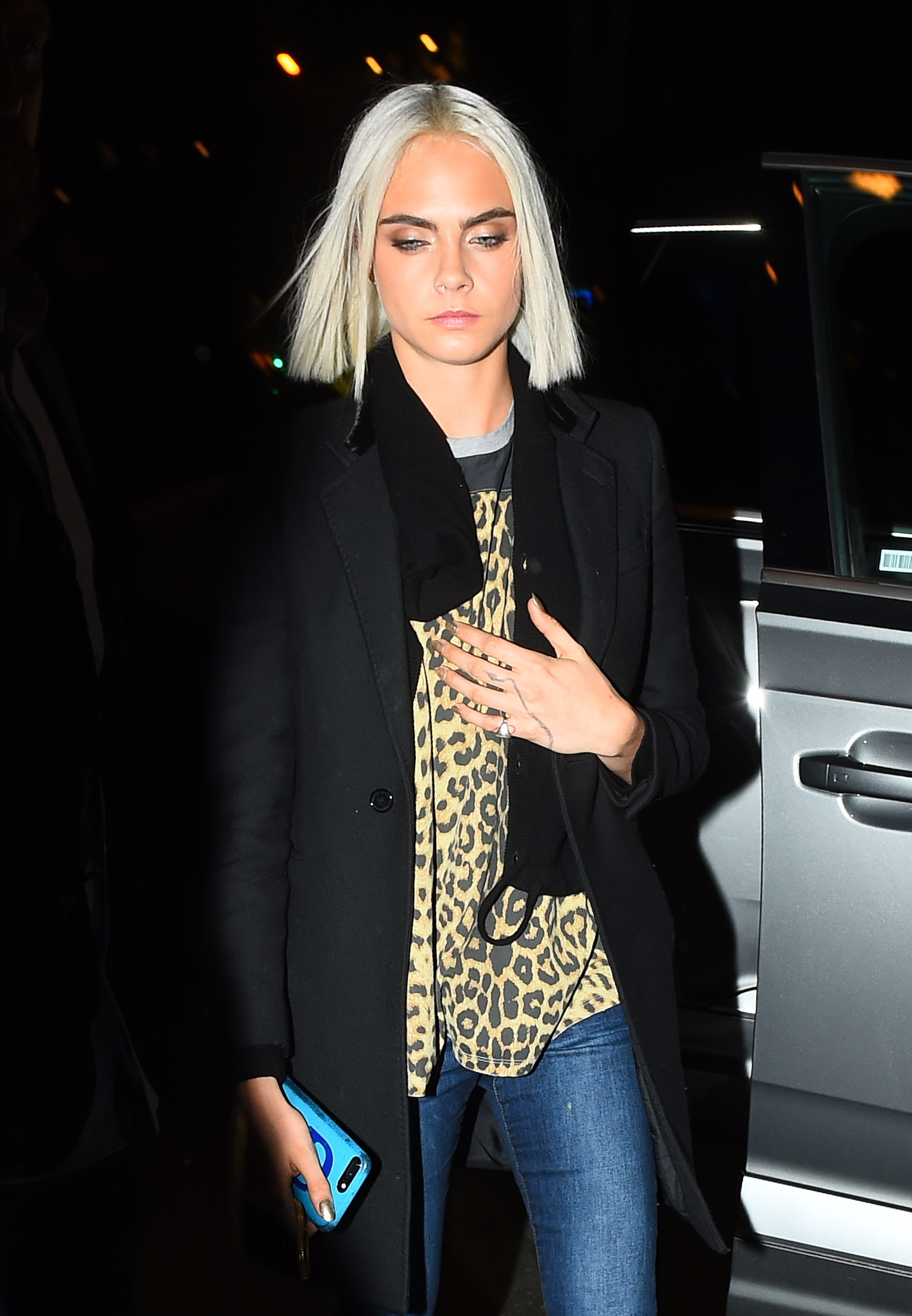 Cara Delevingne Parades Her New Silver Locks In Cool Off-Duty Look During PFW