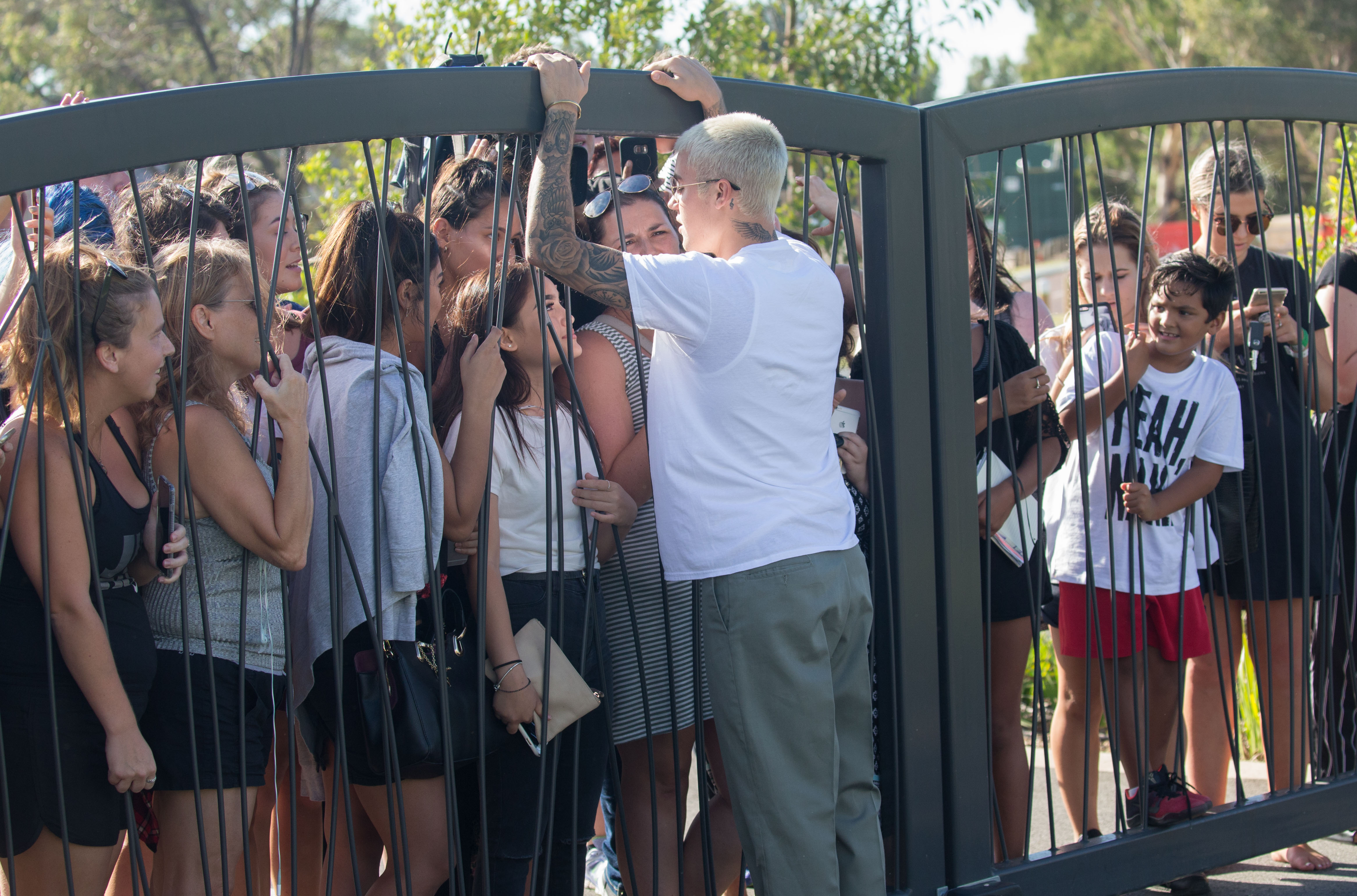 Justin Bieber Greets Hordes Of Girls Behind His Hotel Gate