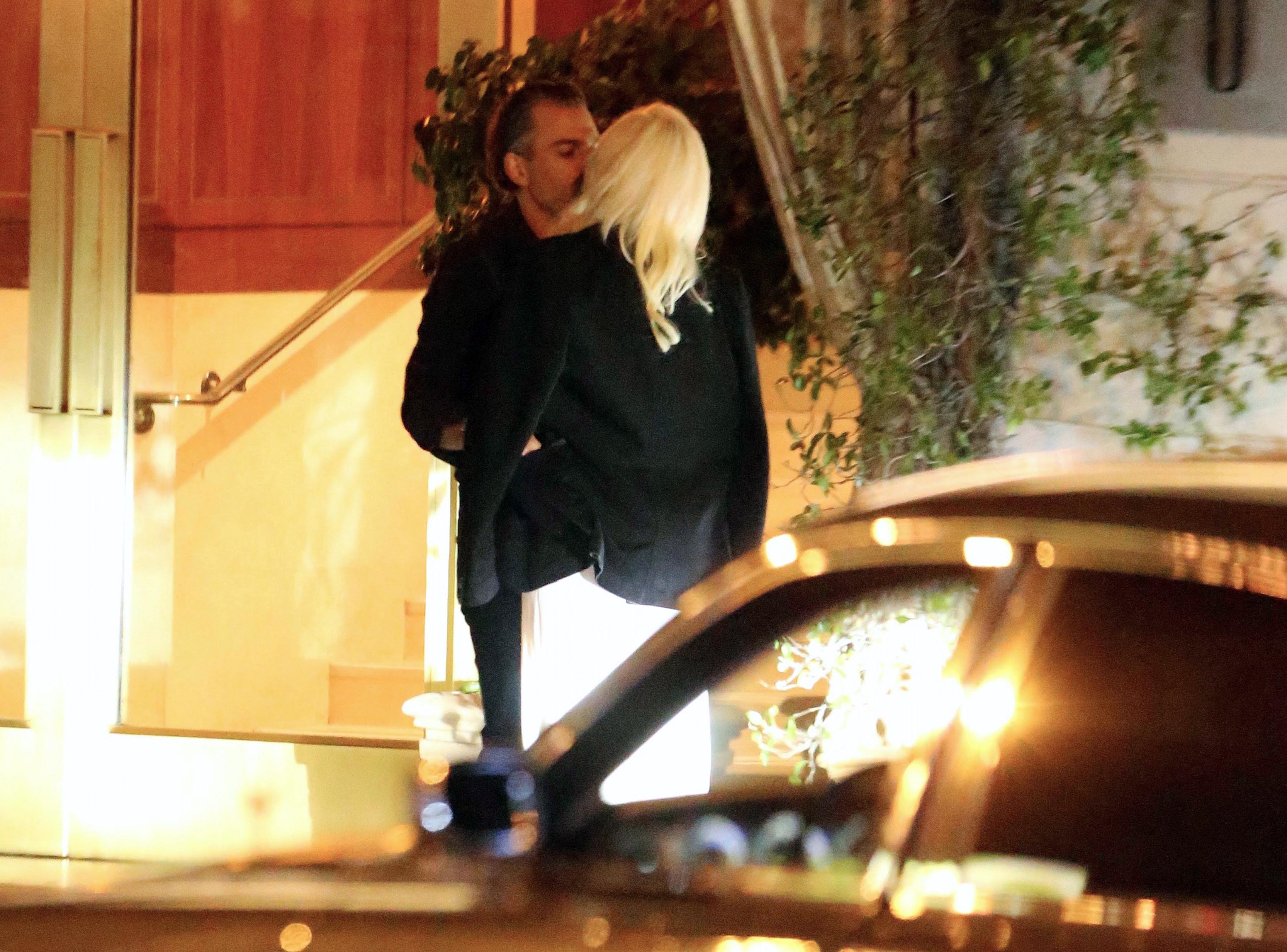 EXCLUSIVE Lady Gaga and Christian Carino Share a Long Kiss while Leaving a Party