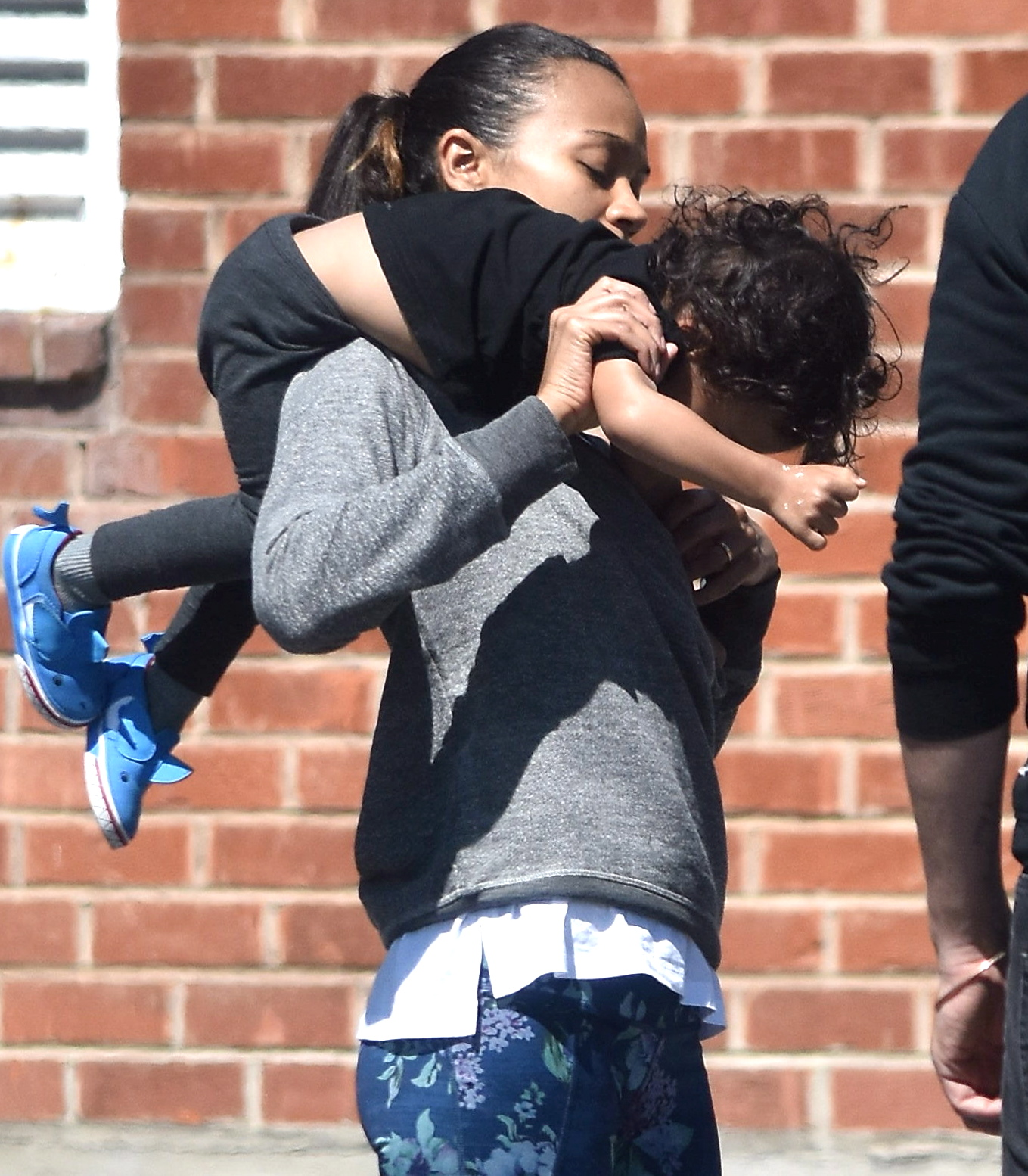 EXCLUSIVE Zoe Saldana Literally Juggles Her Son During Family Outing