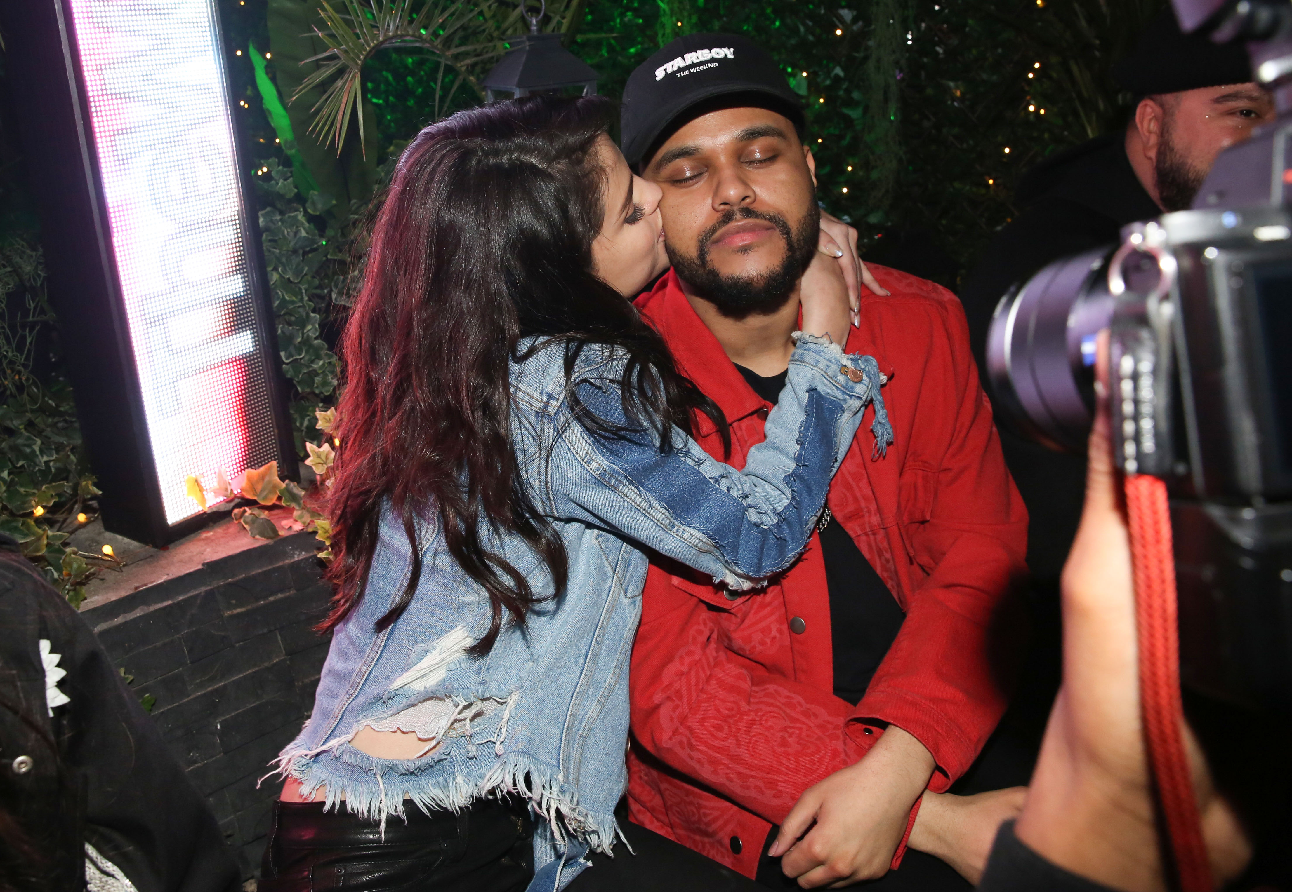 PREMIUM EXCLUSIVE Selena Gomes Plants a Kiss on The Weeknd At After Show Party