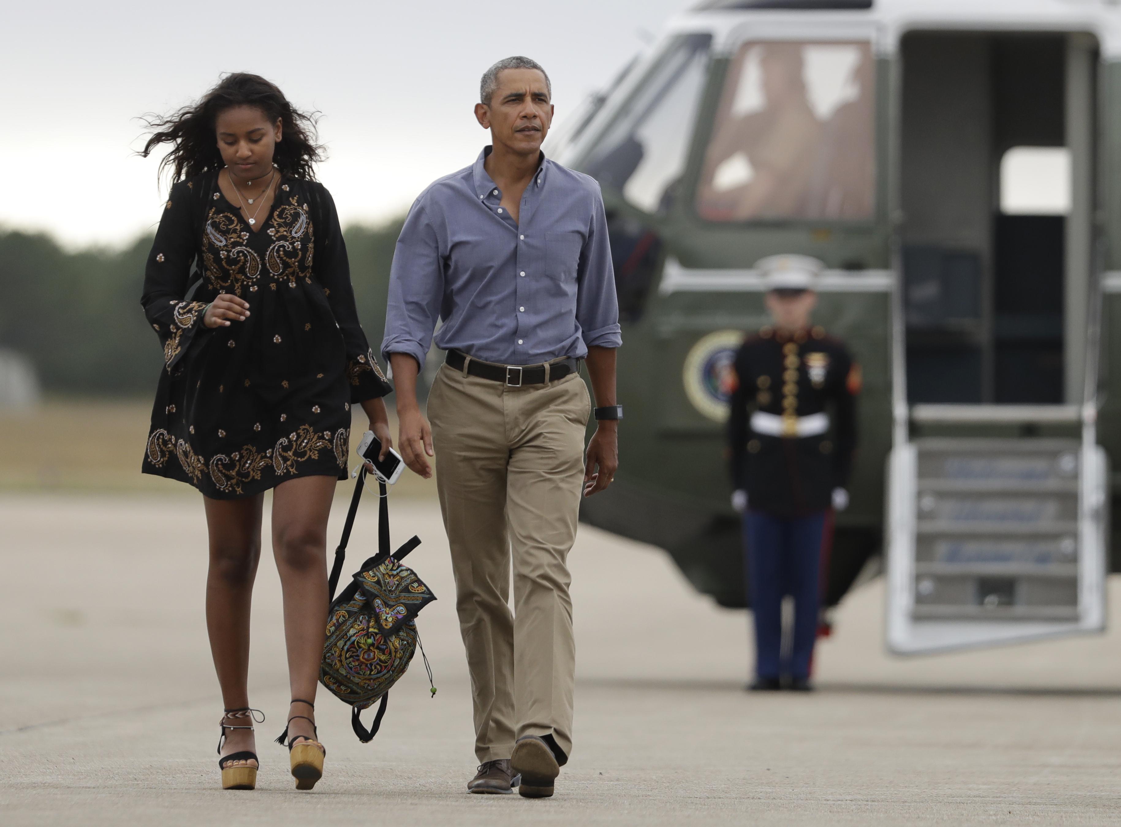 Sasha Obama y Barack Obama
