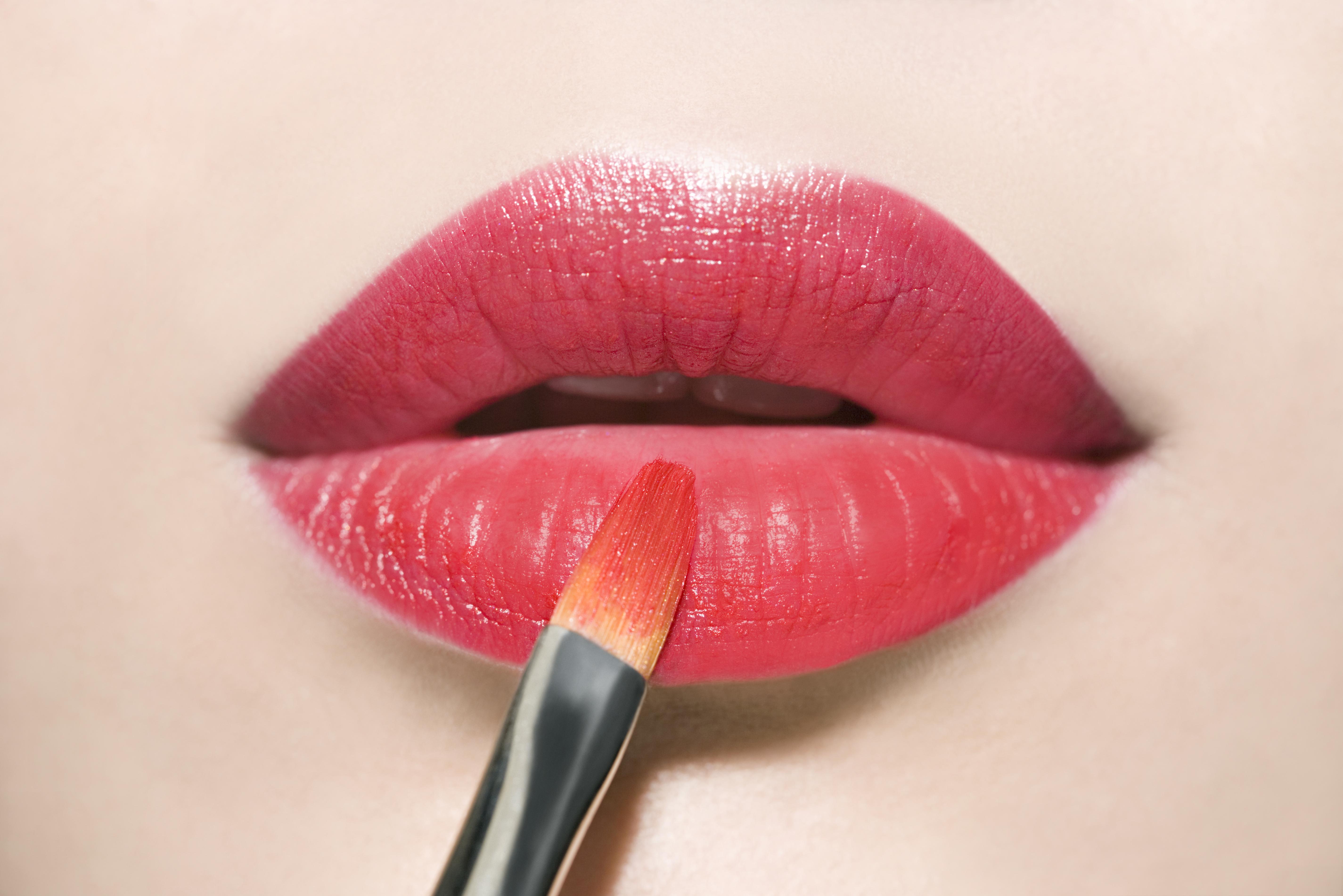 Applying red lipstick