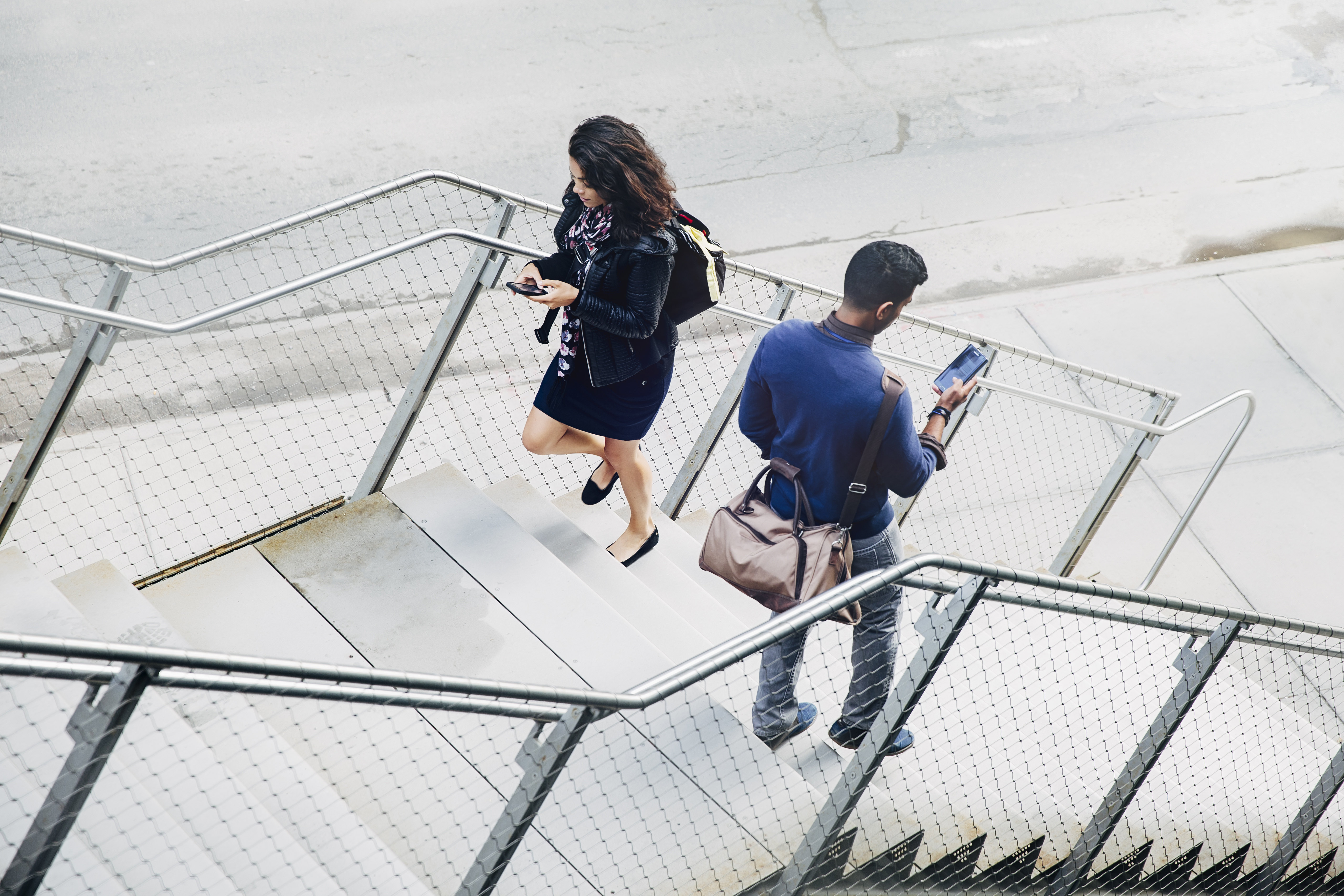 People using cell phones on city steps