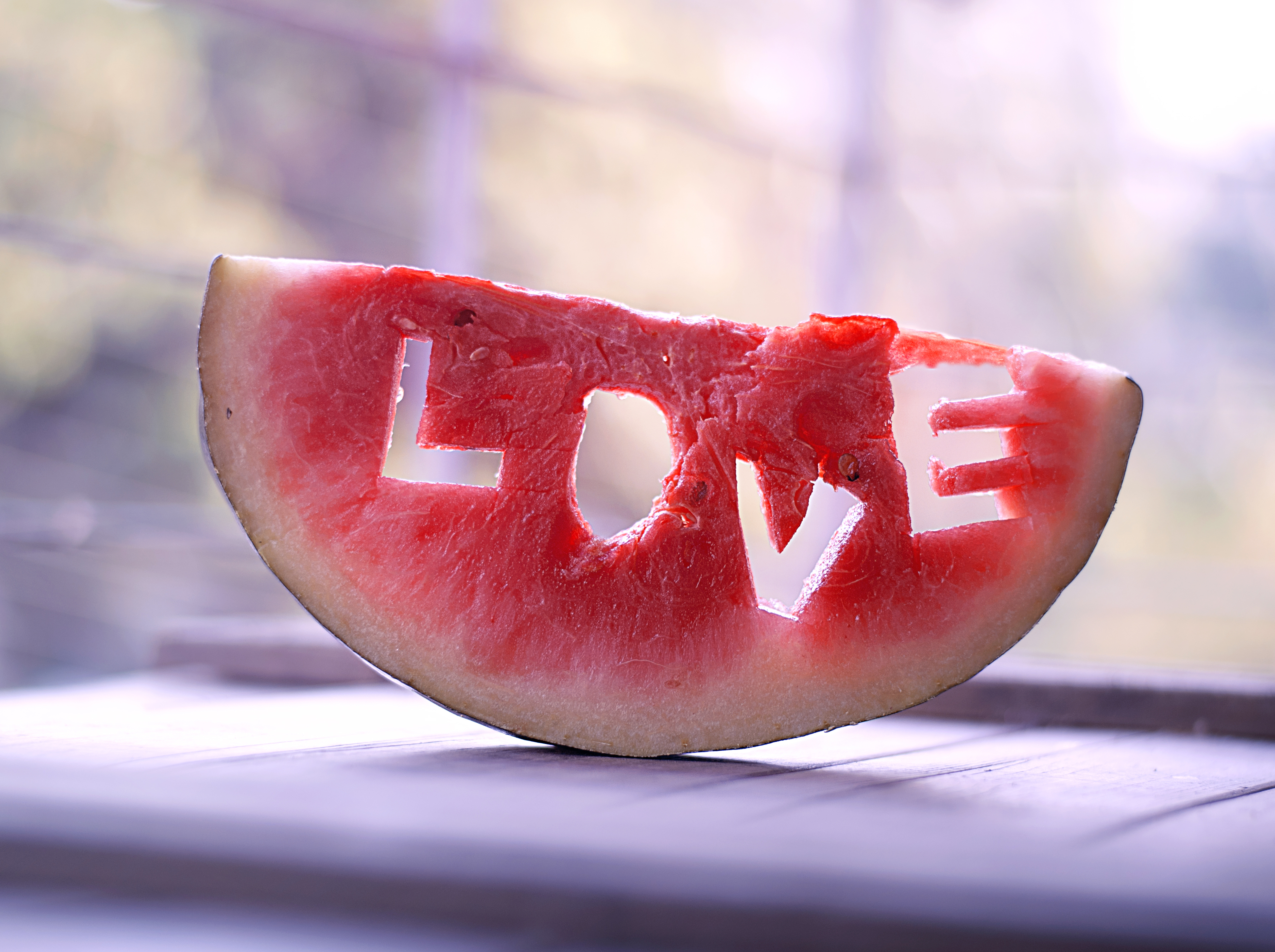 Watermelon with love word curved