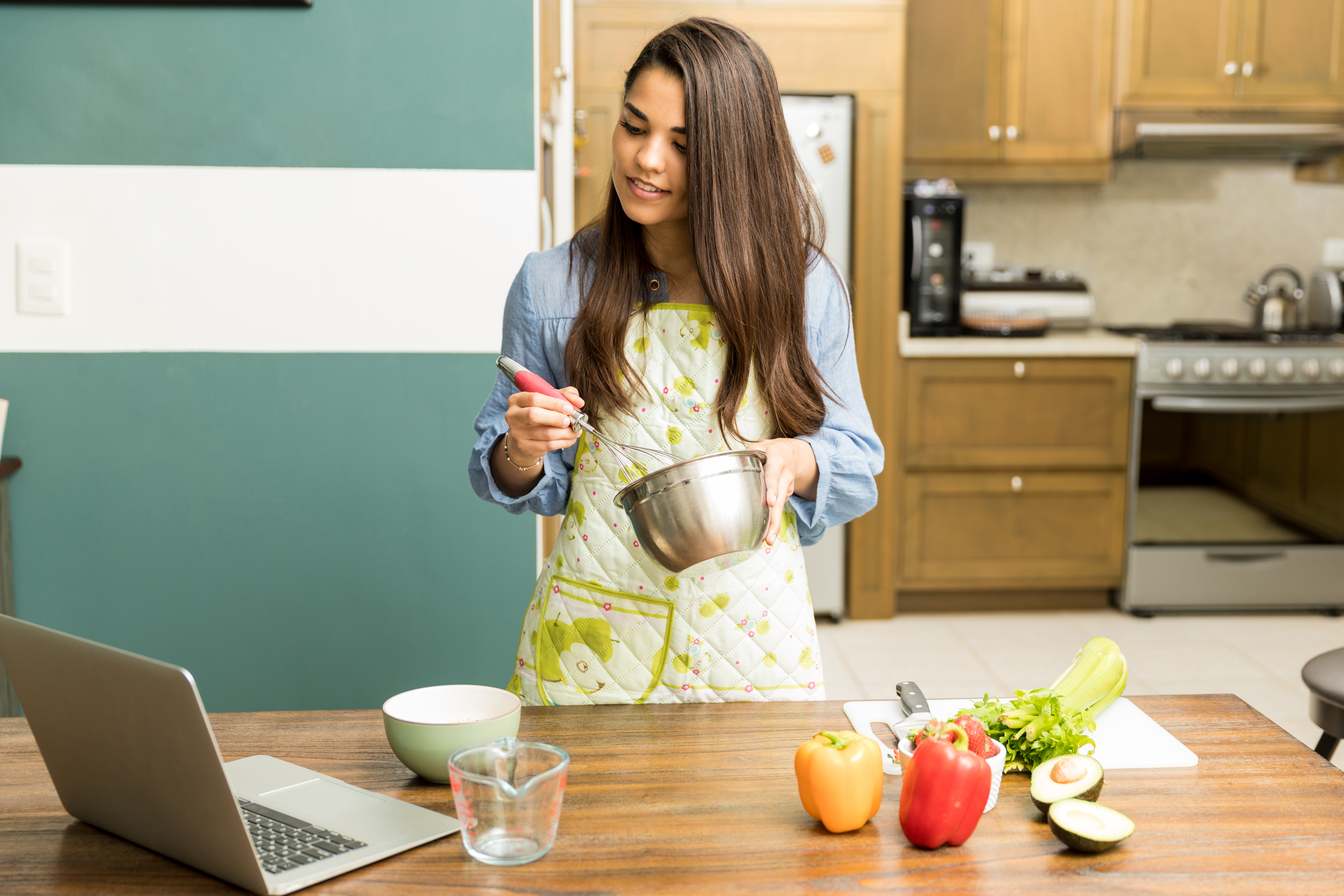 Woman following a cooking tutorial