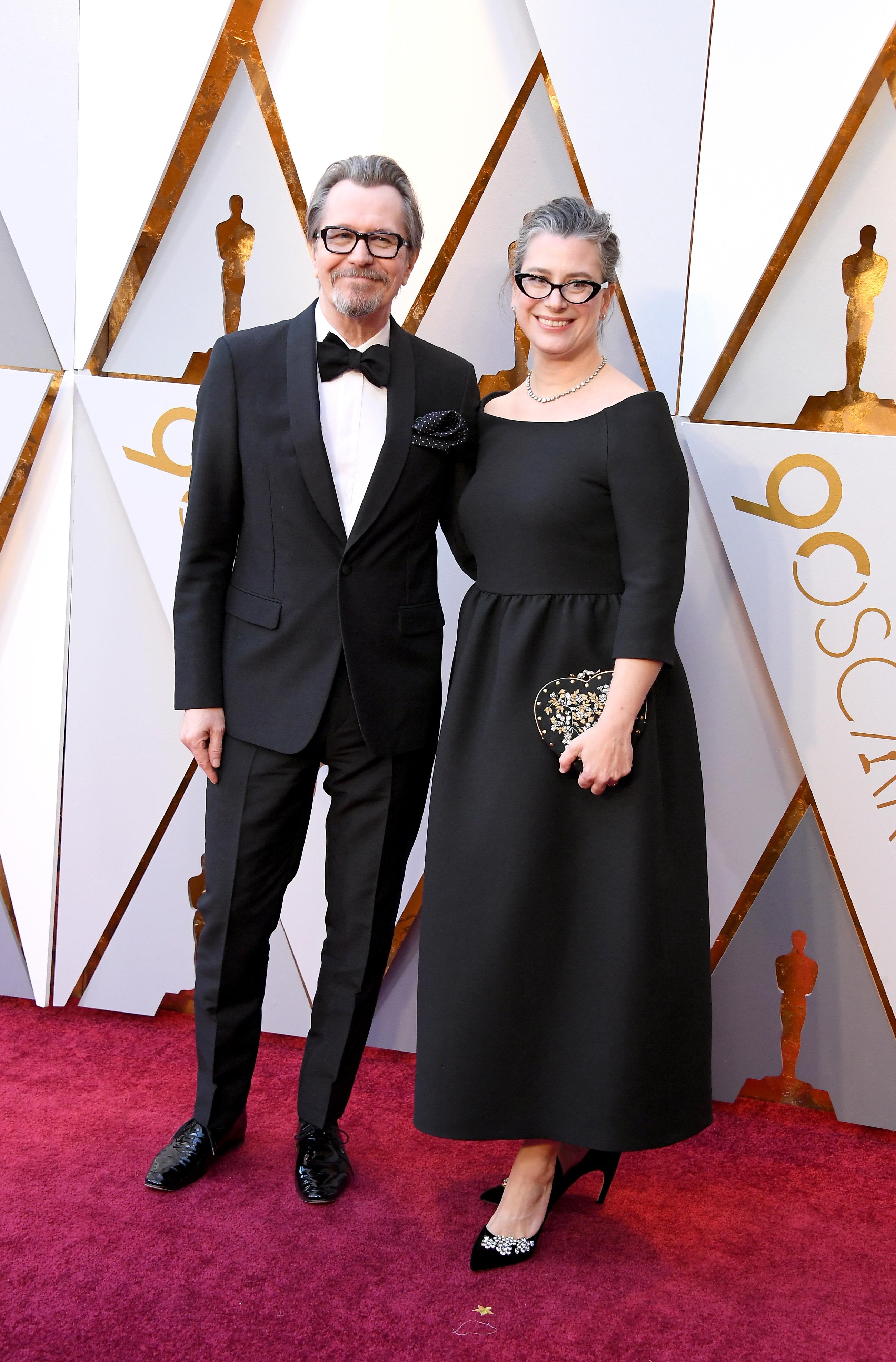 Gary Oldman y Gisele Schmidt