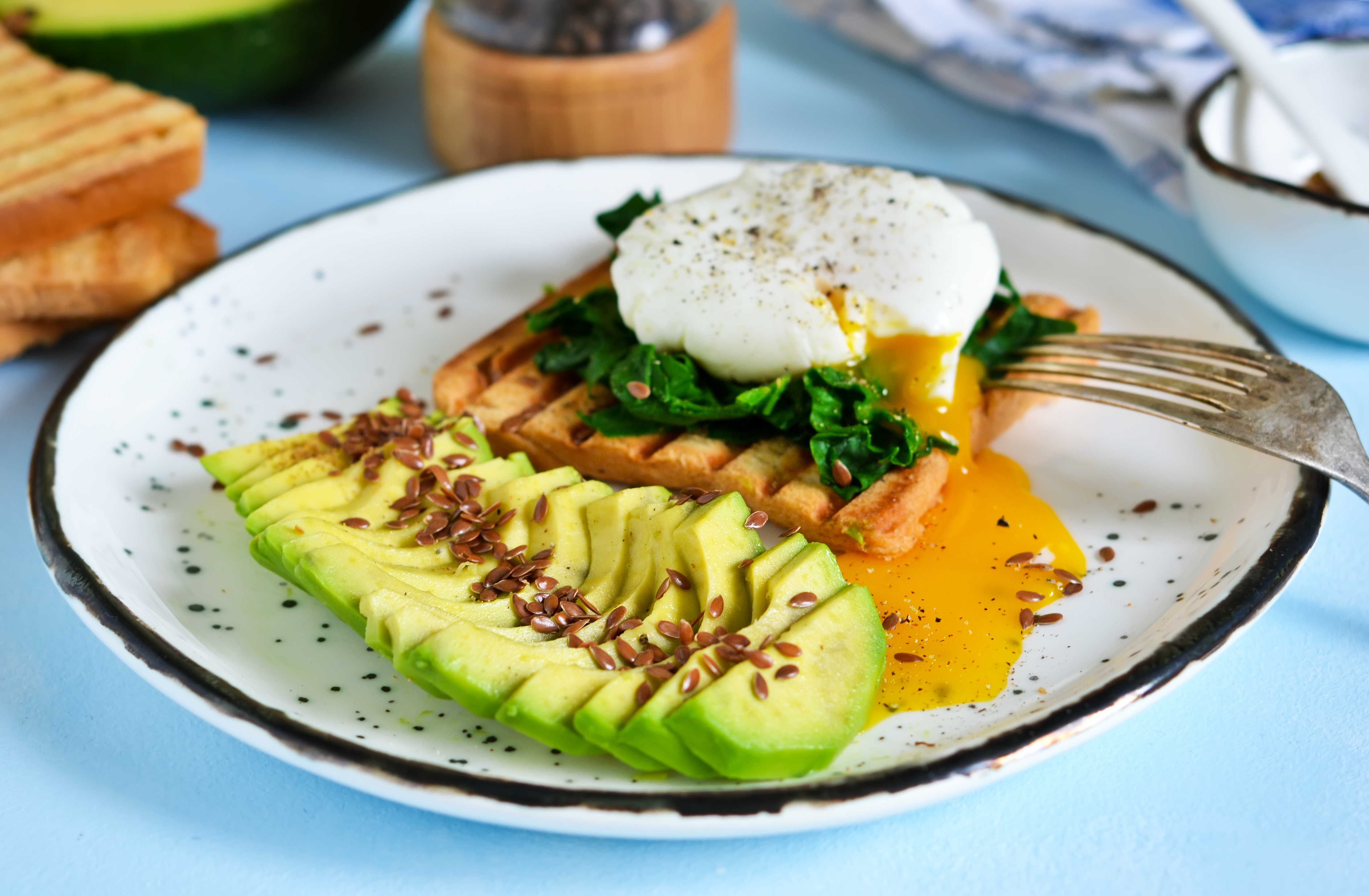 Quick breakfast - poached egg with toast, spinach and avocado.