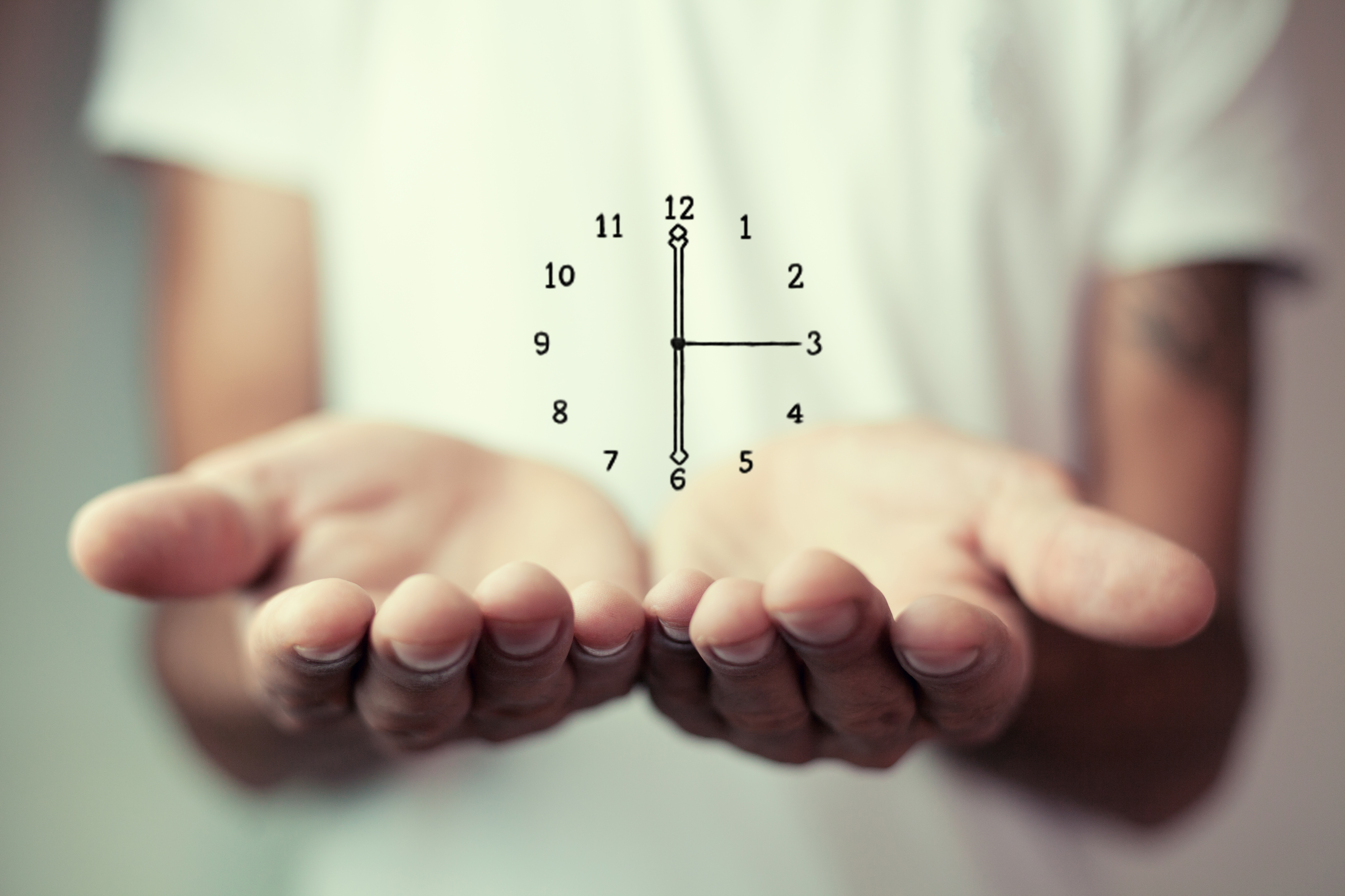 Businessman holding clock. Business time management