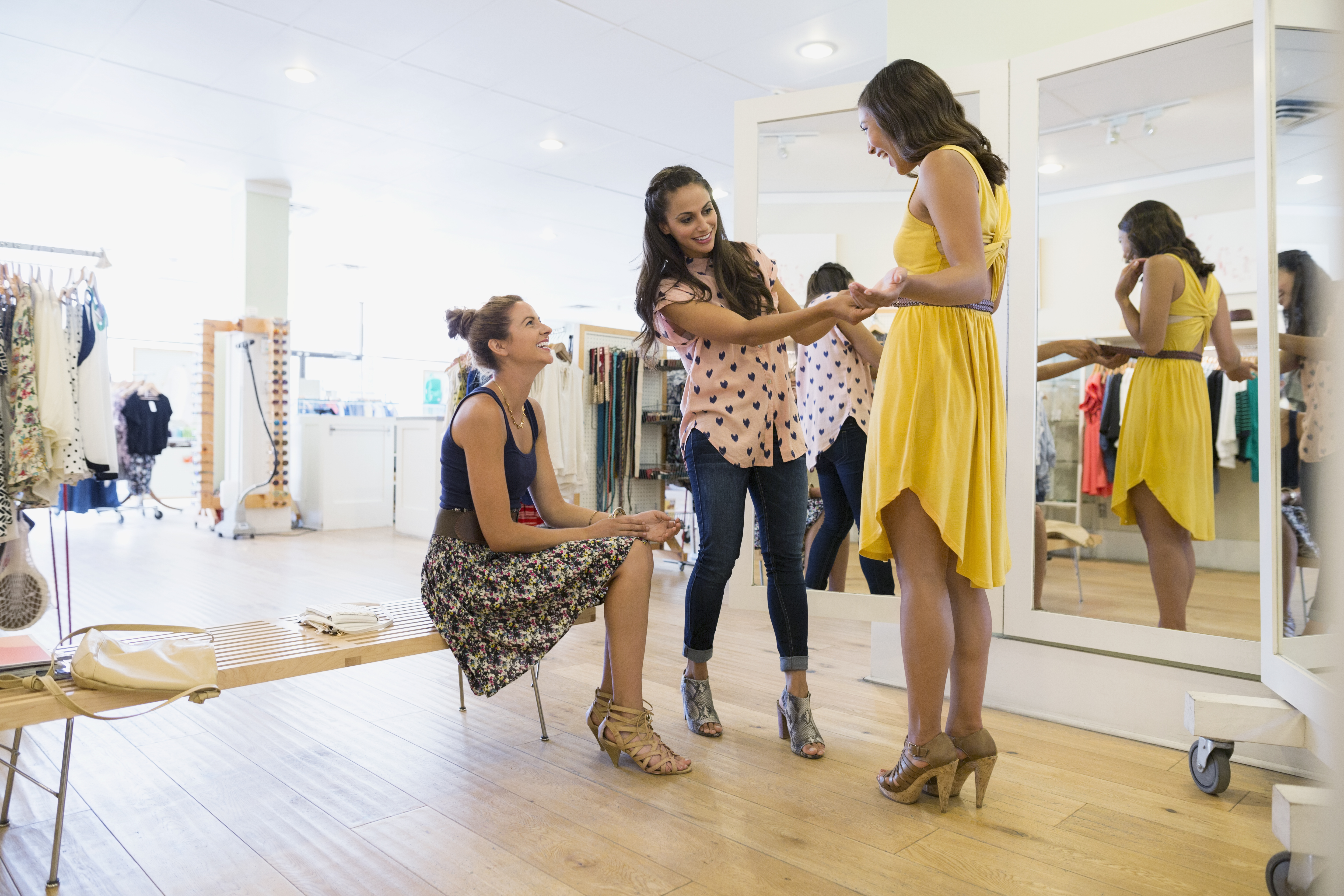 Woman trying on dress in clothing shop