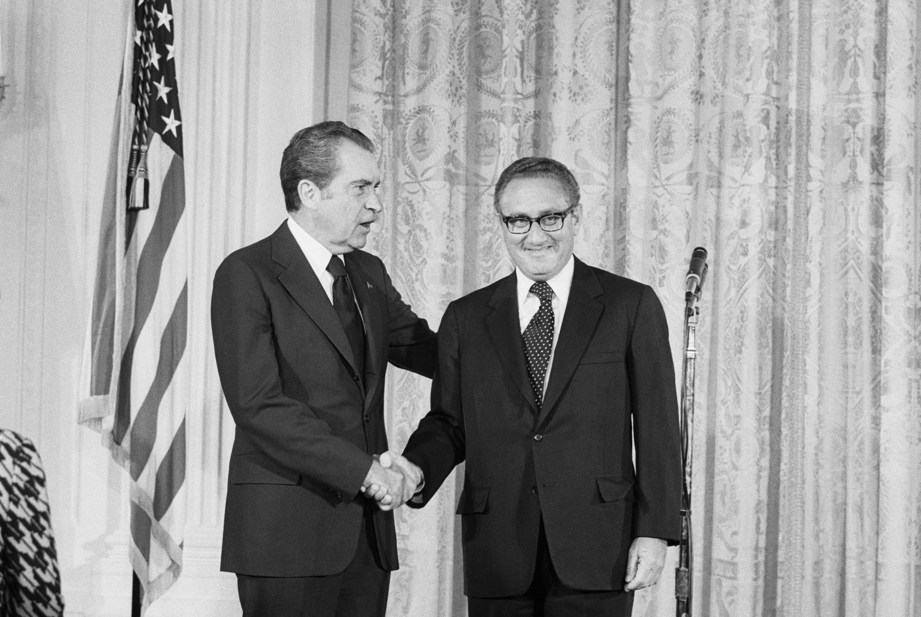 Nixon Shakes Hands with Henry Kissinger
