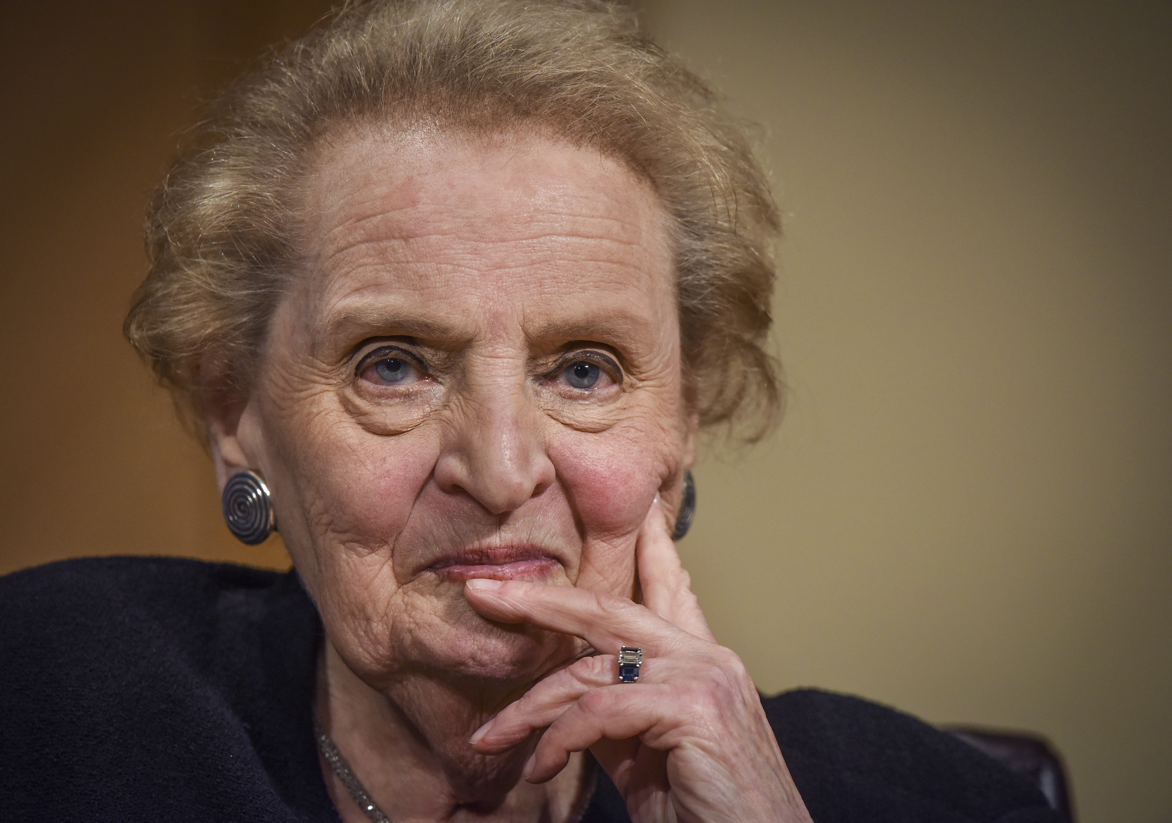 Former Secretary of State Madeleine Albright with her hand on her head