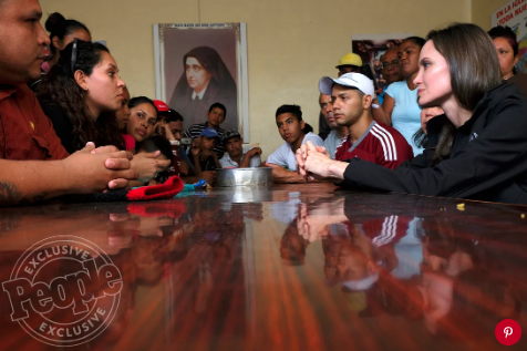 Angelina Jolie listens to a Peruvian volunteer during a sit-down meeting in Tumbes, Peru.