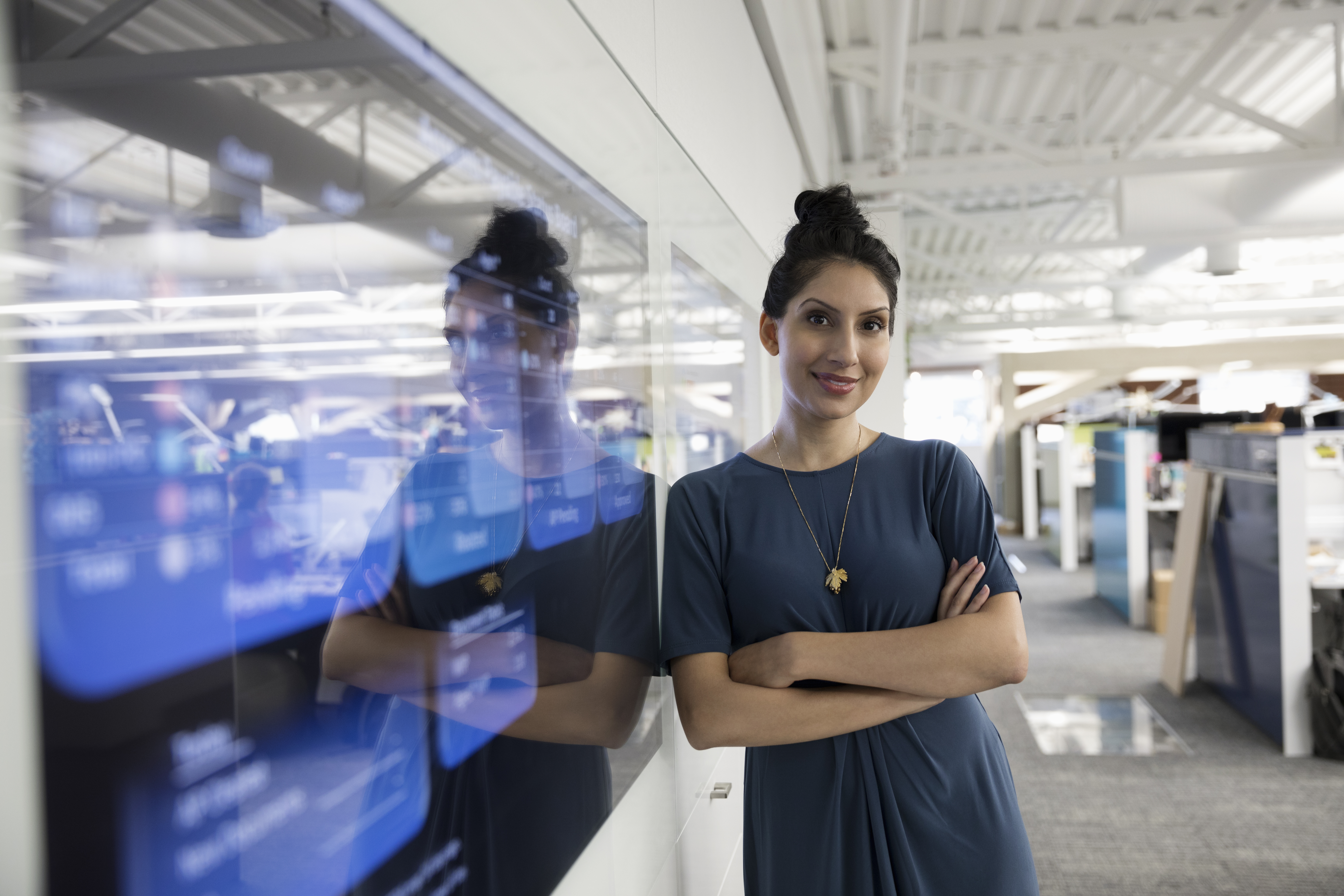 Portrait confident businesswoman at screen in office