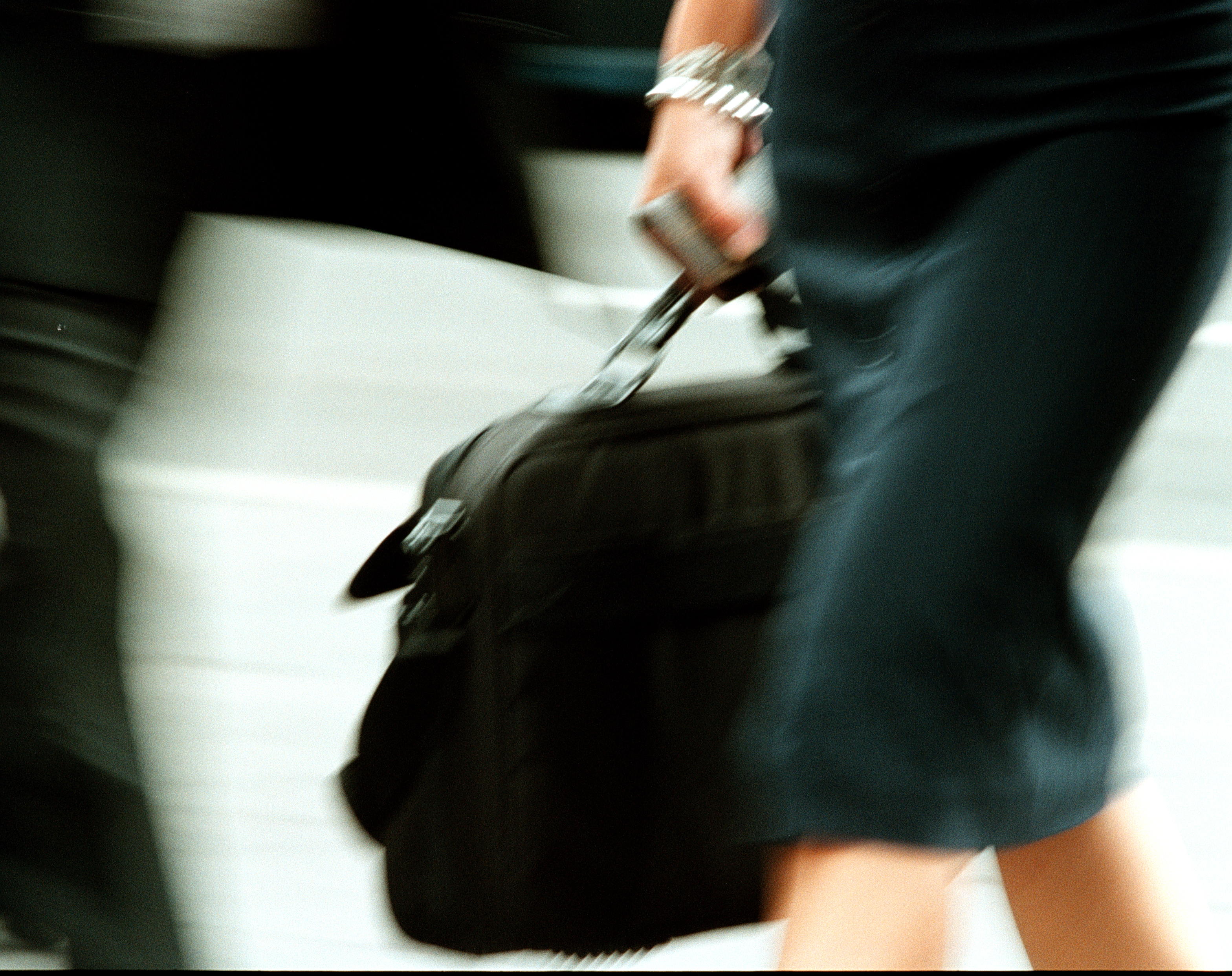 Detail of a businesswoman with a black briefcase
