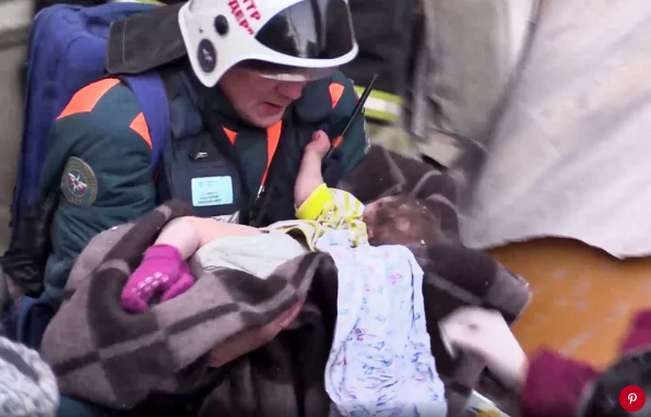 Rescuers pull baby boy from rubble after building collapse in Russia