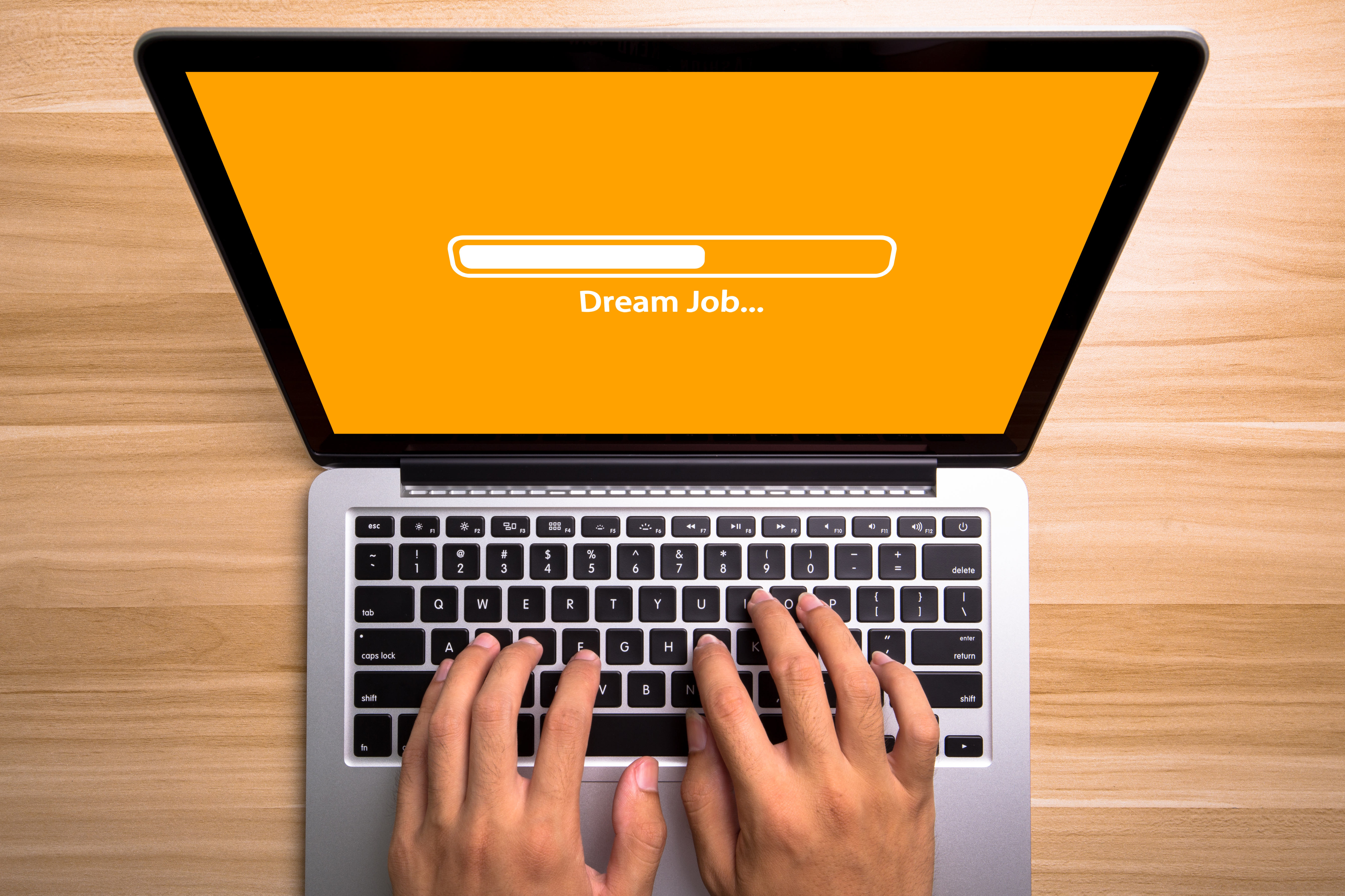 Dream Job Concept Laptop Screen With Typing Hands On Keyboard
