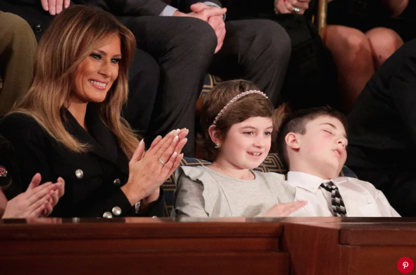 Joshau Trump (right), a Delaware sixth-grader, sleeps during President Donald Trump's State of the Union address on Tuesday nightAlex Wong/Getty