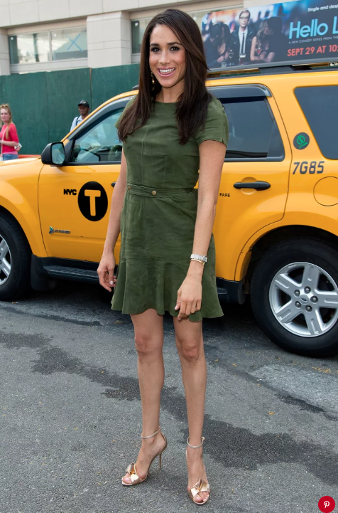 Meghan Markle in front of a yellow taxi in 2014.