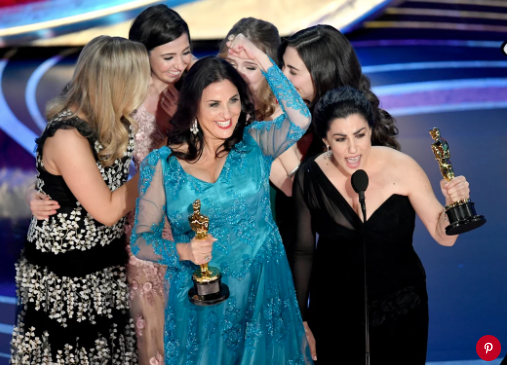 Melissa Berton and Rayka Zehtabchi accepting their award. Photo: Kevin Winter/Getty