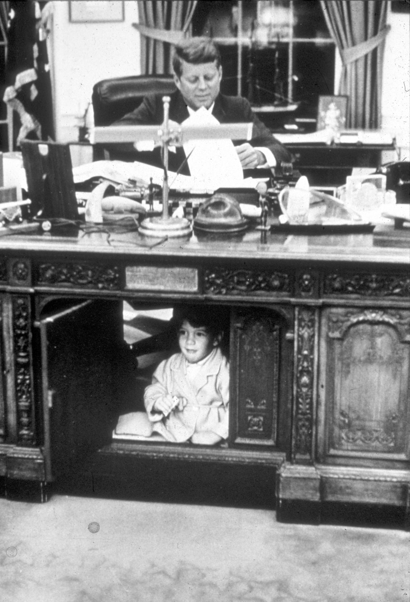 John Kennedy Jr. playing in the Oval Office
