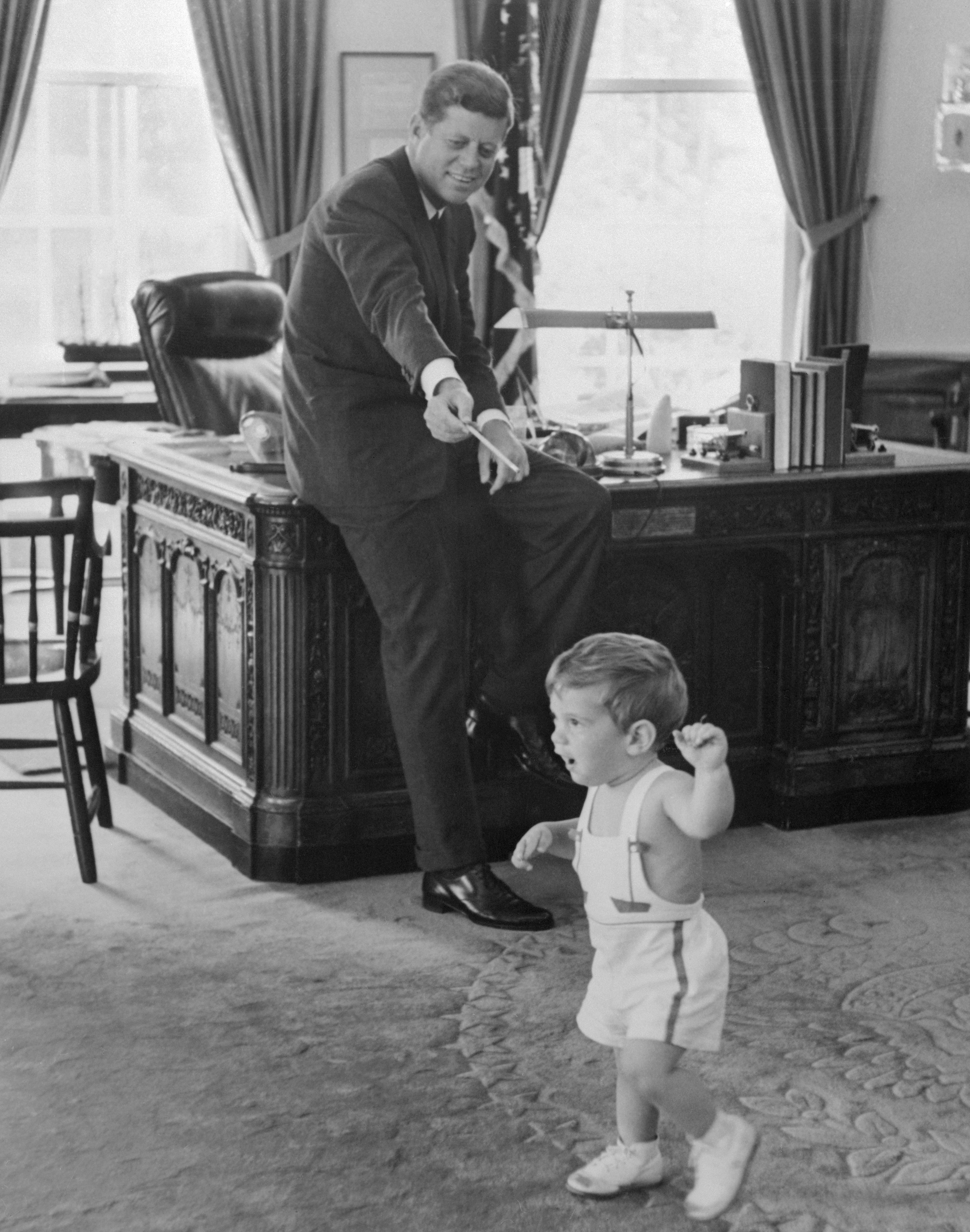 John F. Kennedy with 18 Month Old Son John Jr.
