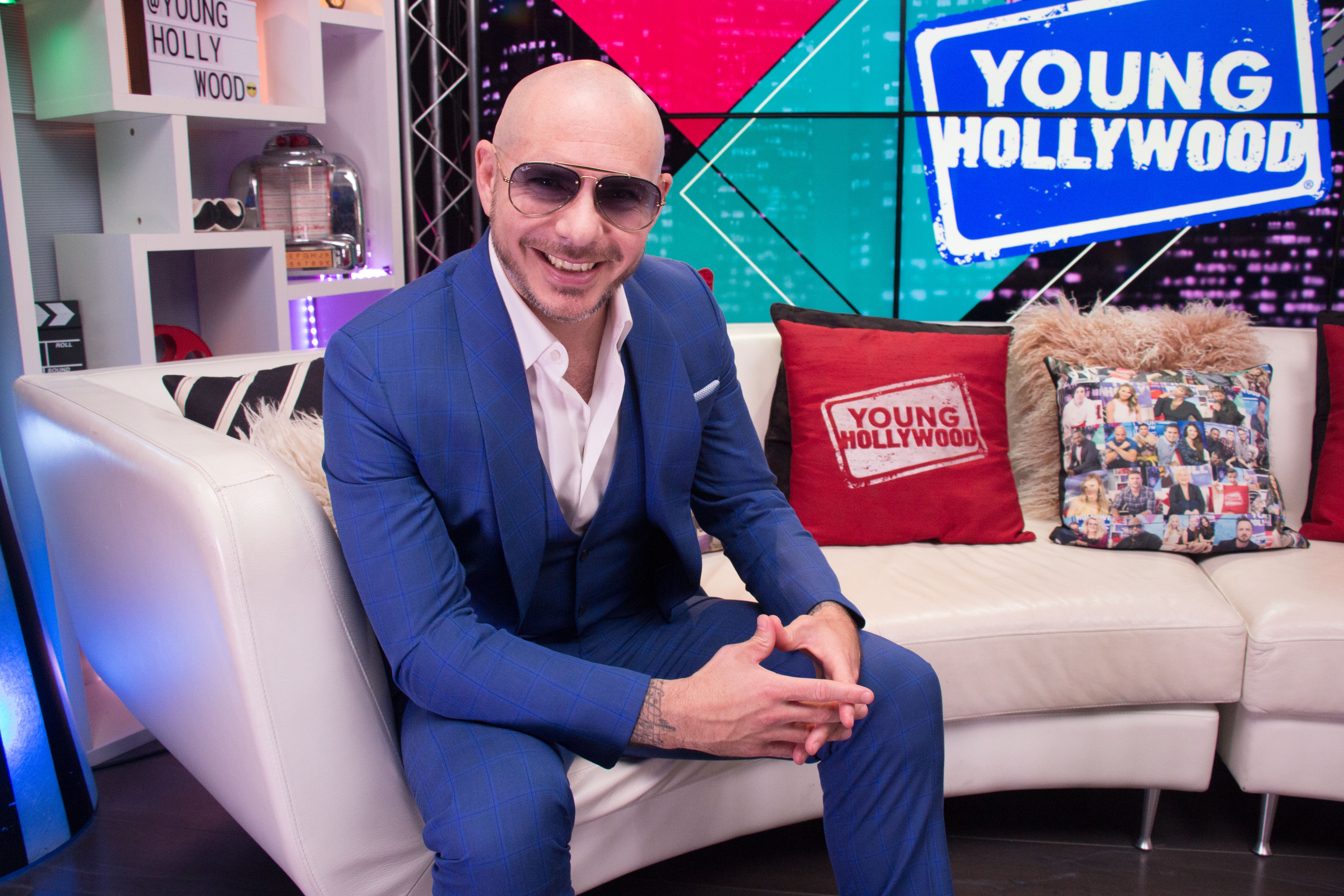 Pitbull Visits Young Hollywood Studio