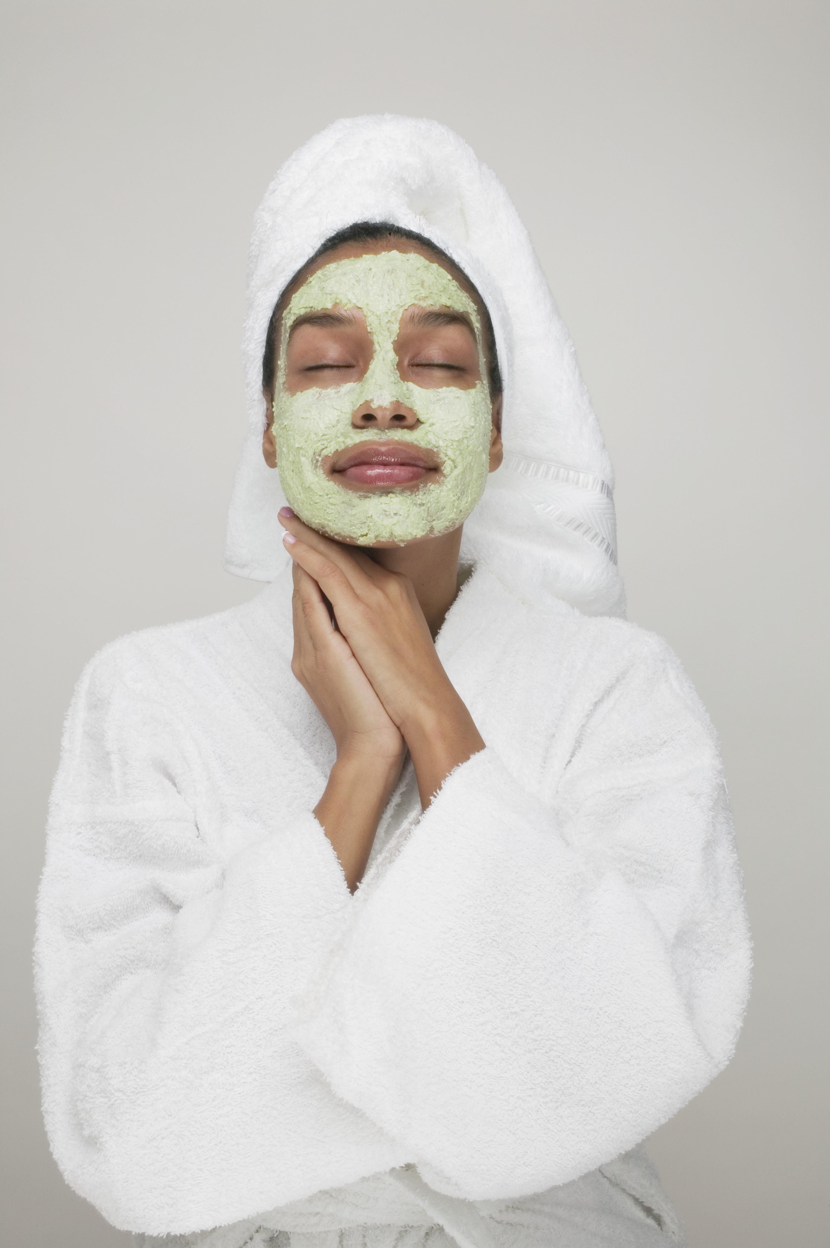 Young woman wearing a facial mask