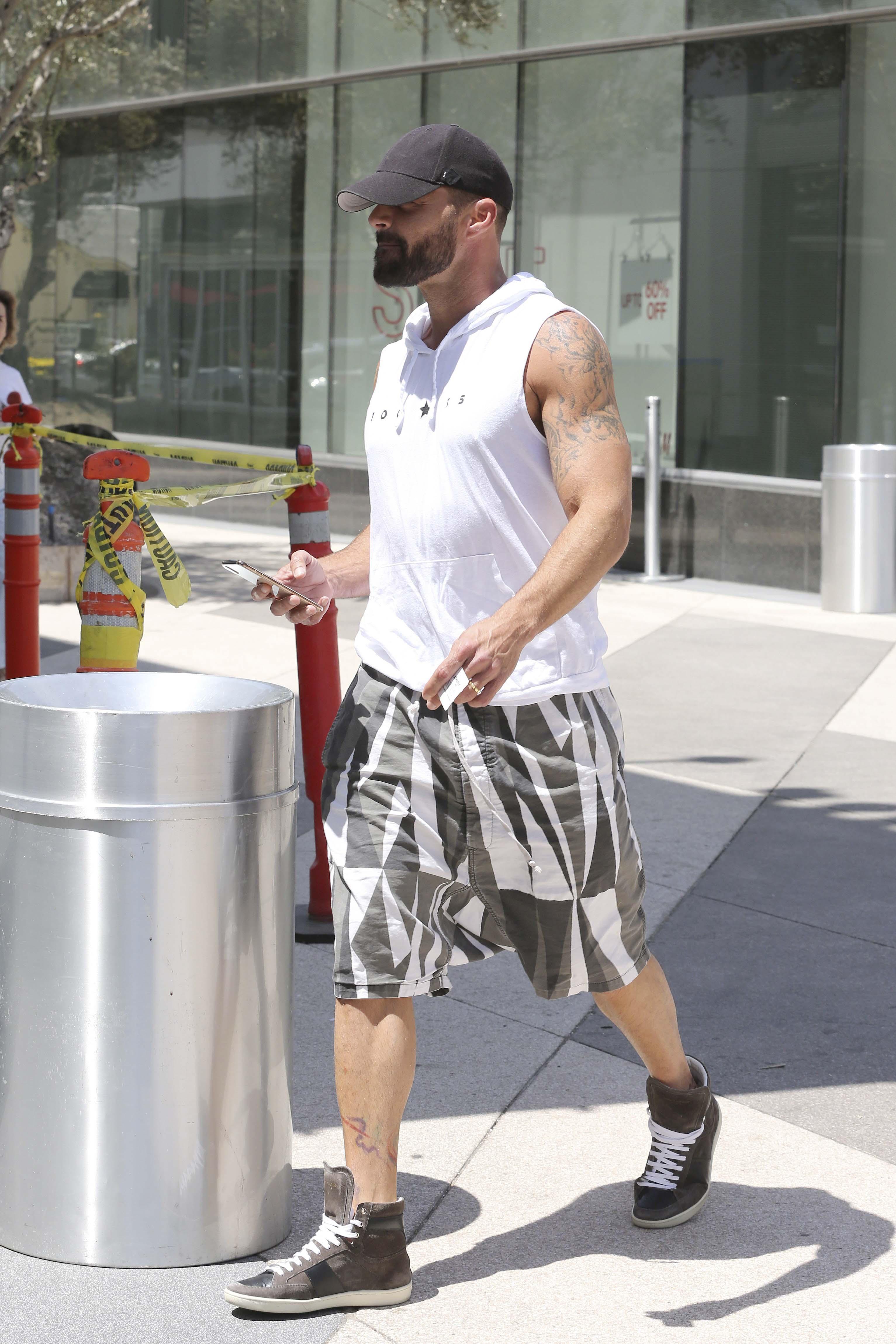 Ricky Martin gimnasio músculos