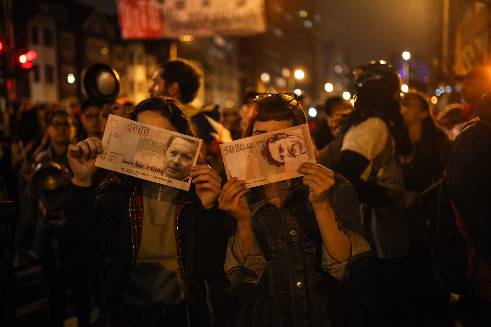 Demonstrators light torches during protests for the third day in Colombia