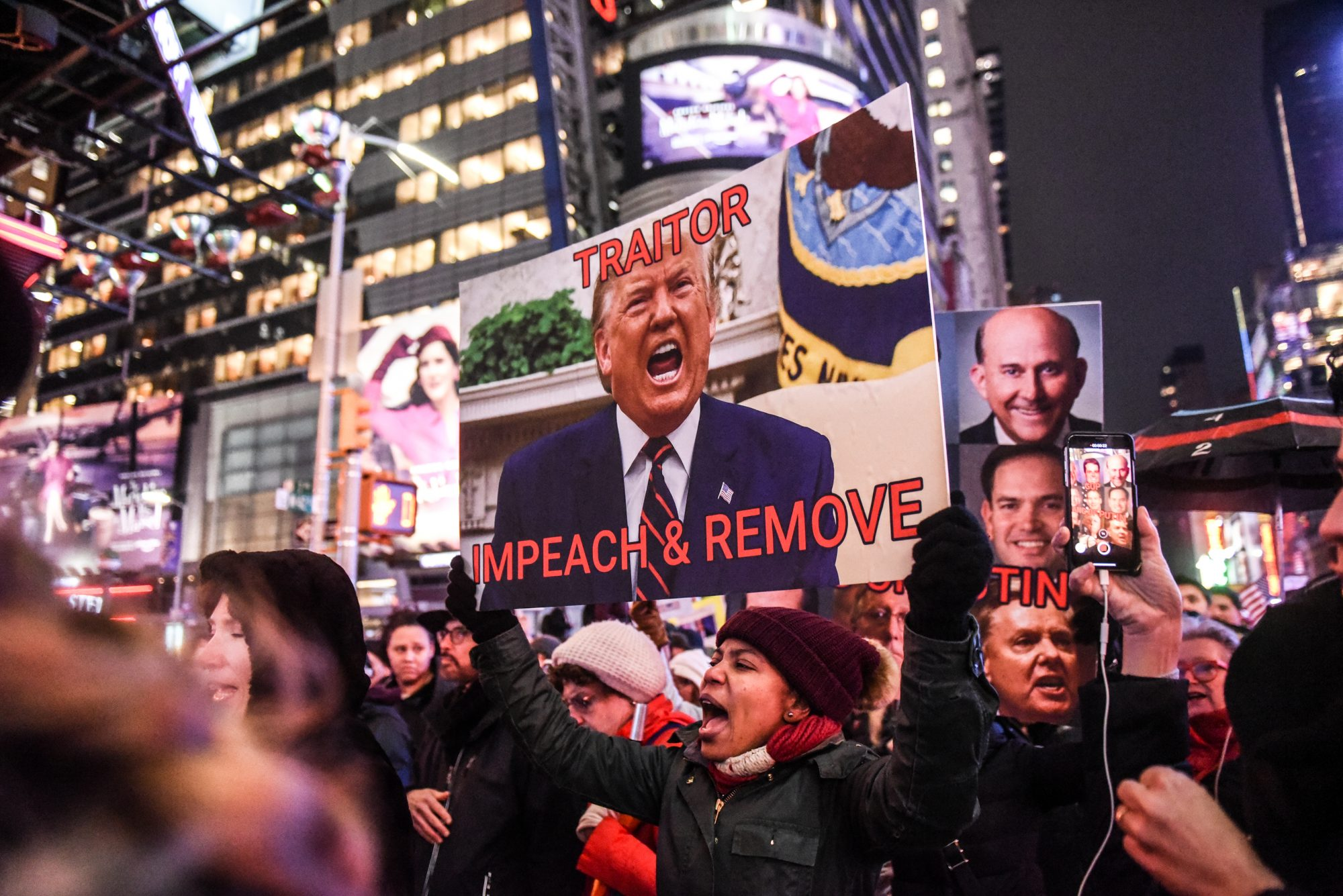 Rallies Across The Country Urging Congress To Impeach President Trump Held On Eve Of House Vote