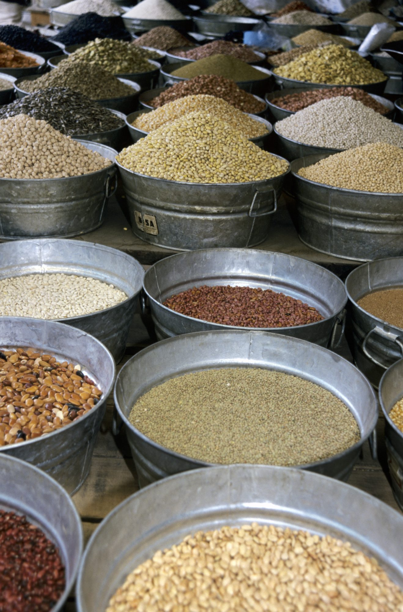 Tubs of grain and seed in a Oaxacan market, Oaxaca, Mexico