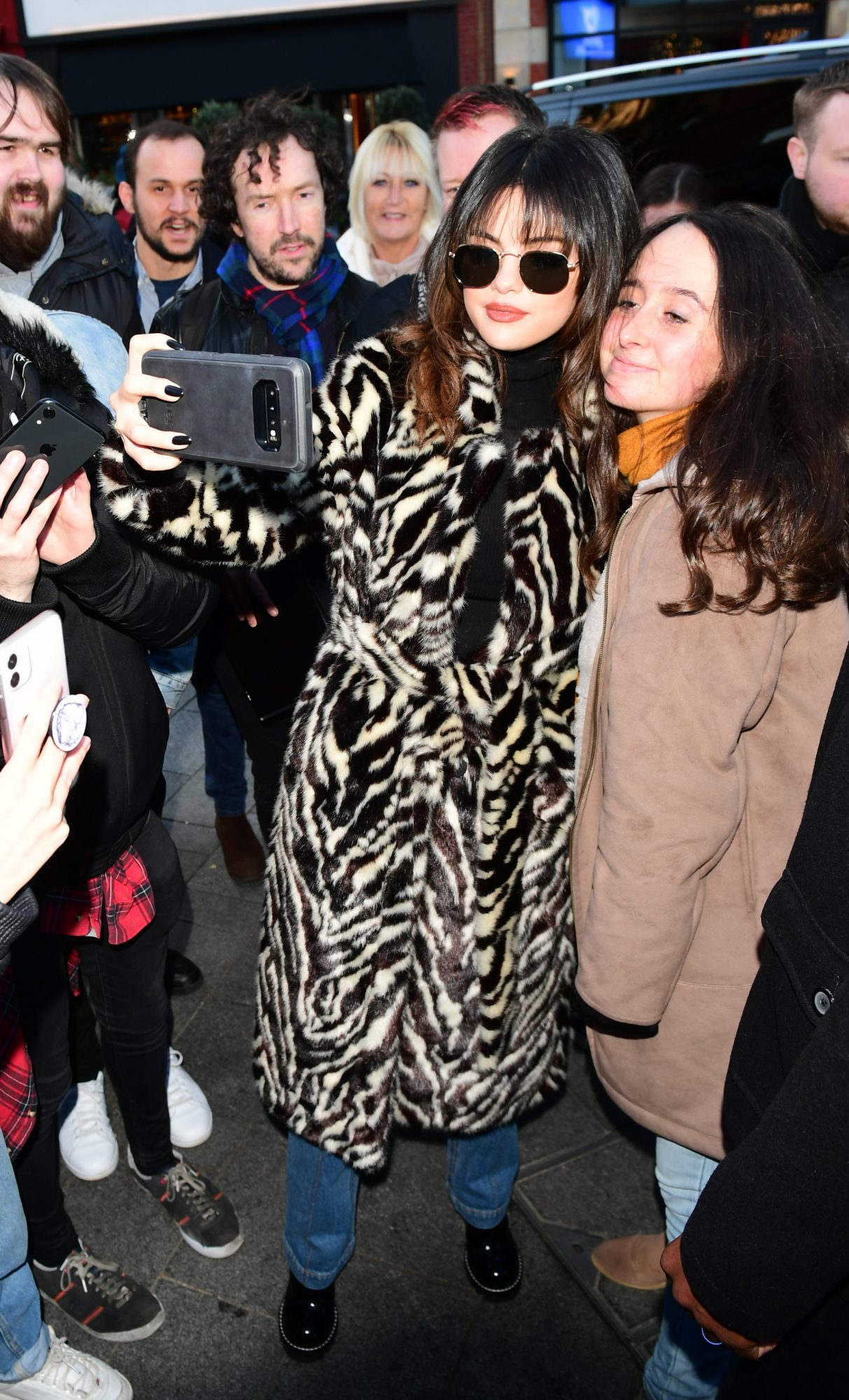 Selena Gomez Looks Fashionable in Animal Print Coat as She Greet