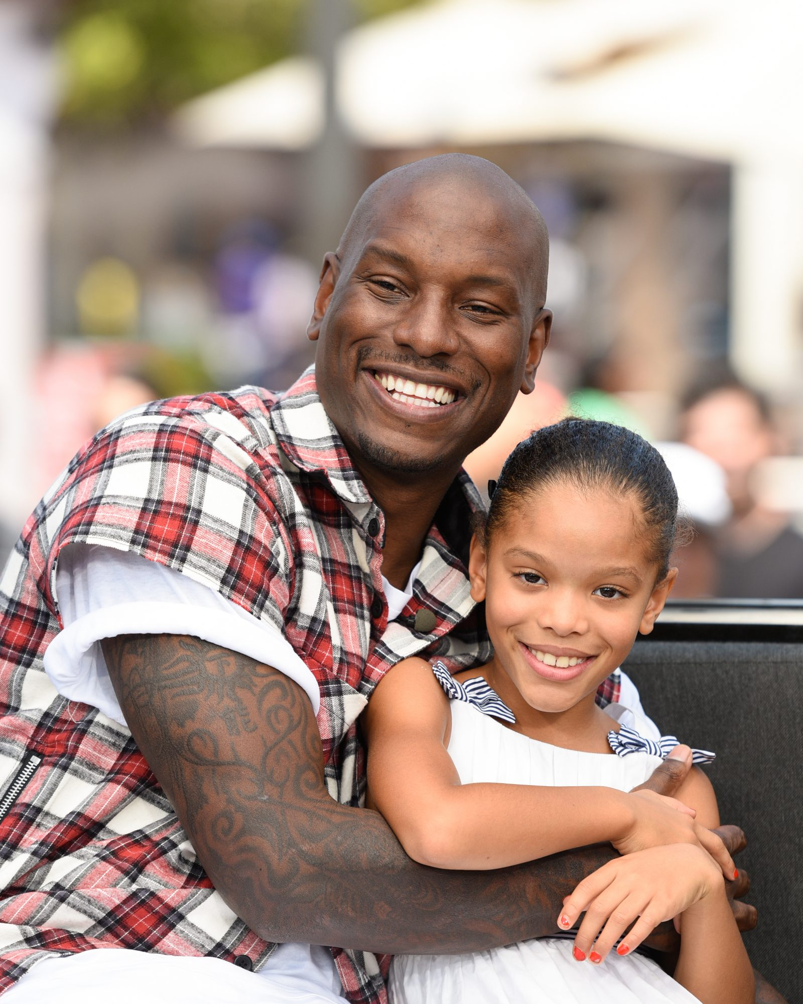 Tyrese Gibson (L) and his daughter Shayla Somer Gibson visit