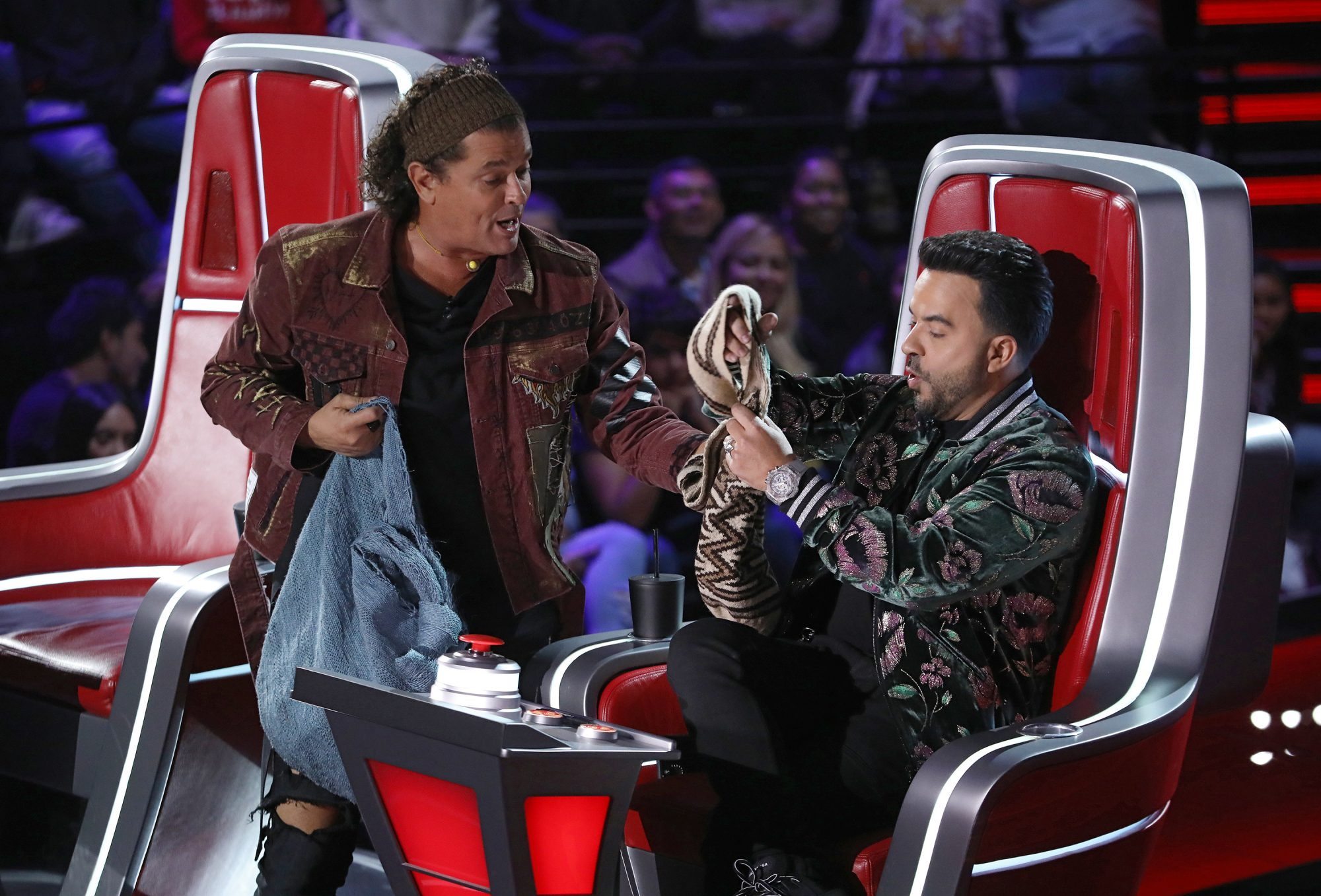 """Carlos Vives and Luis Fonsi are seen during Telemundo's """"La Voz"""" blind auditions"""
