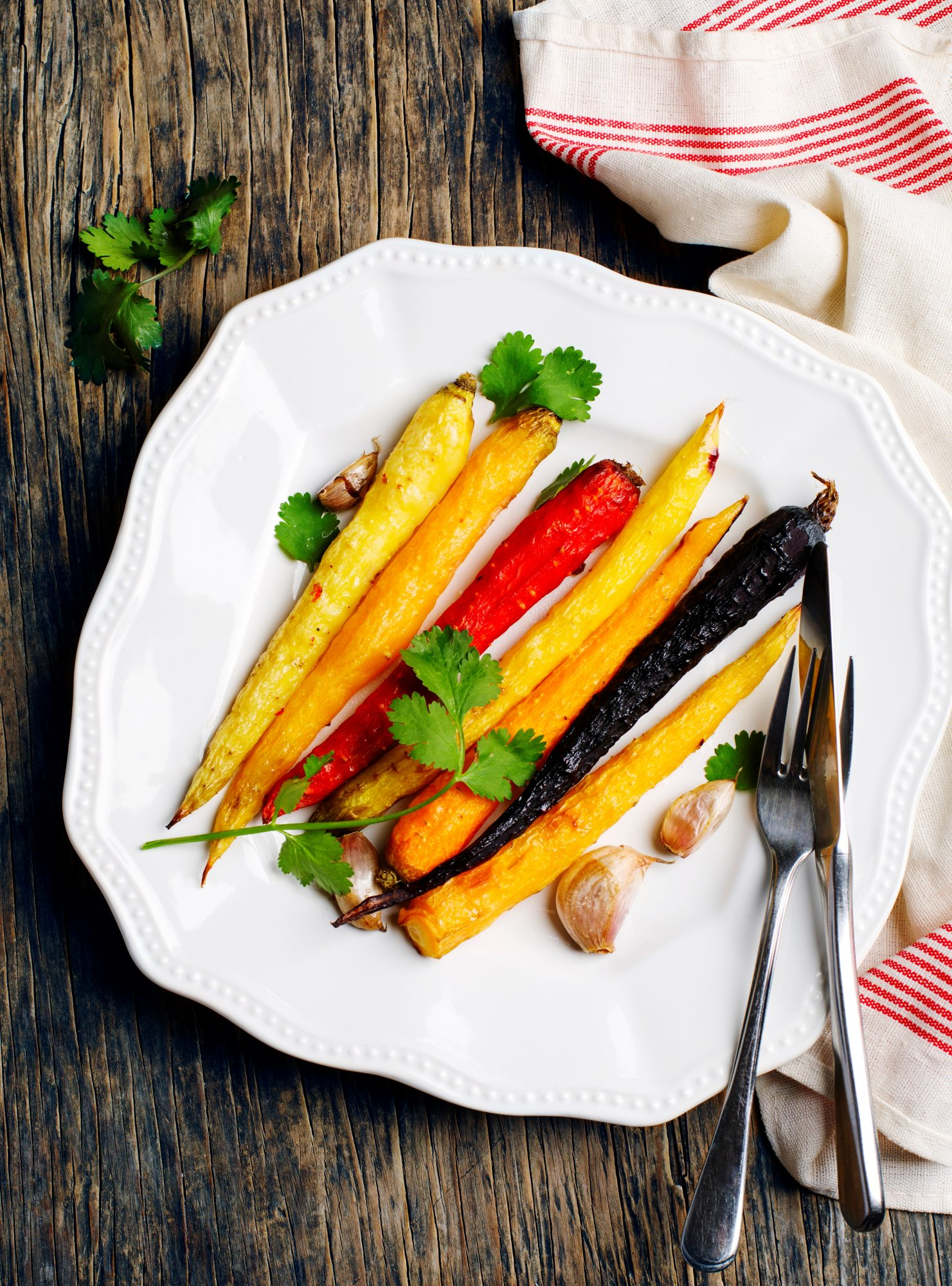 Baked carrots on a plate, top view