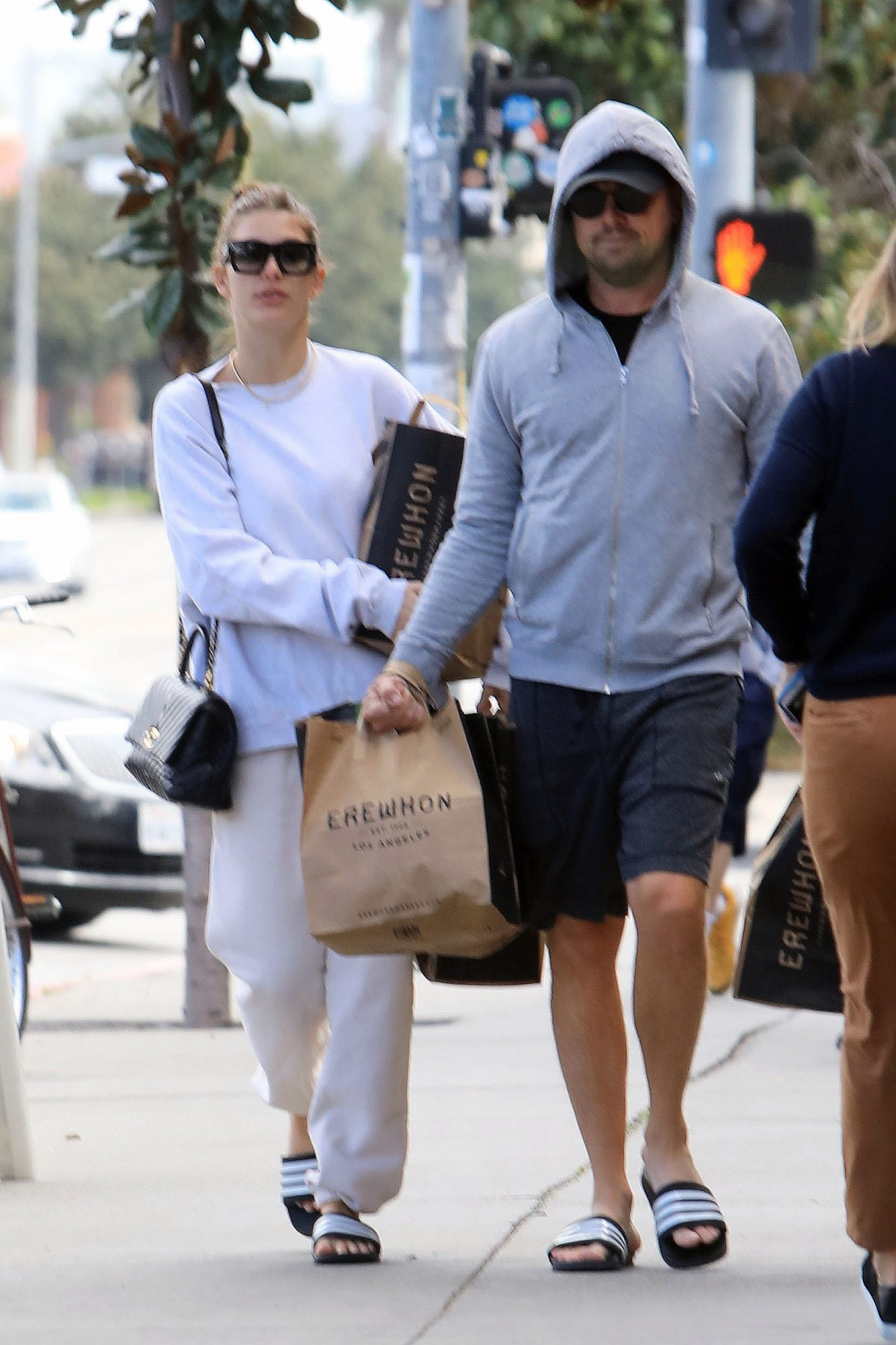 Leonardo DiCaprio and Camila Morrone step out for some grocery shopping in Los Angeles wearing matching slides.