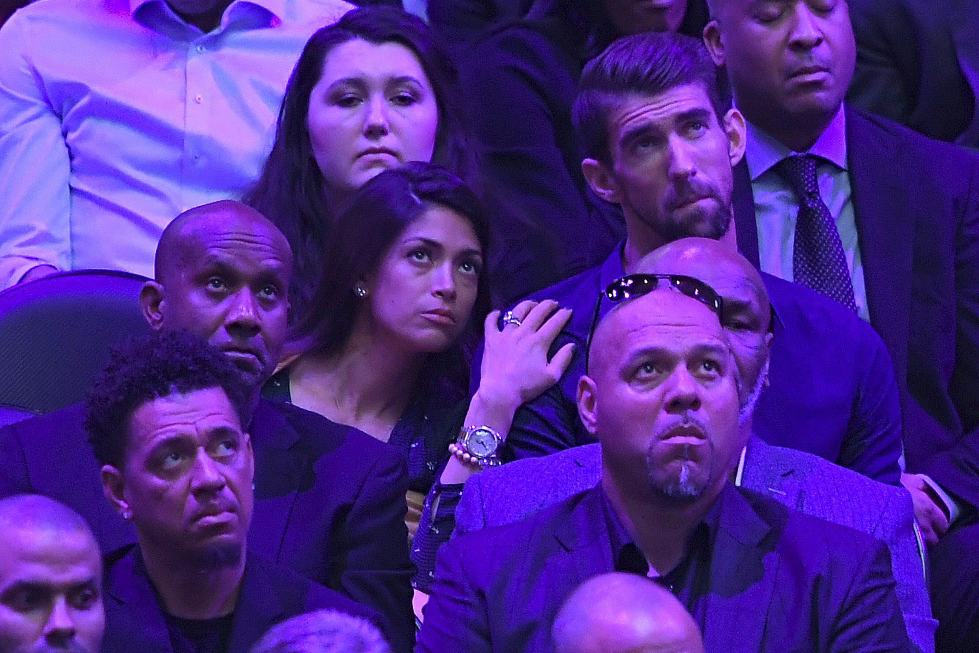 Michael Phelps and Nicole Johnson en el servicio de Kobe Bryant y su hija Gianna