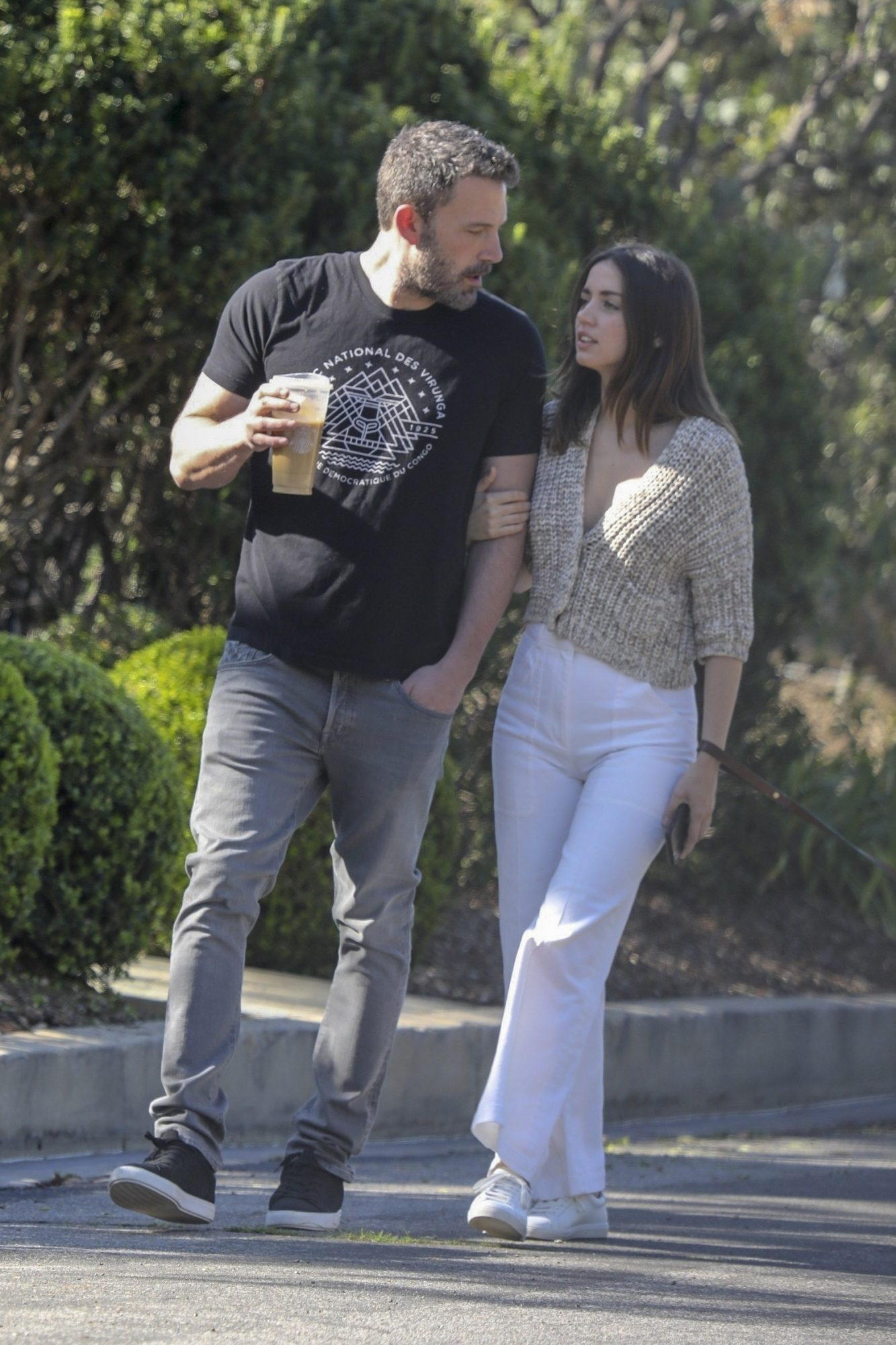 Ben Affleck out for a morning stroll with his new girlfriend Ana de Armas.