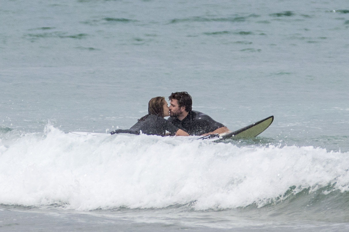 Liam Hemsworth and Gabriella Brooks are all loved up as they enjoy a surf together on Phillip Island. Gabriella could be seen holding her stomach as she left the surf.