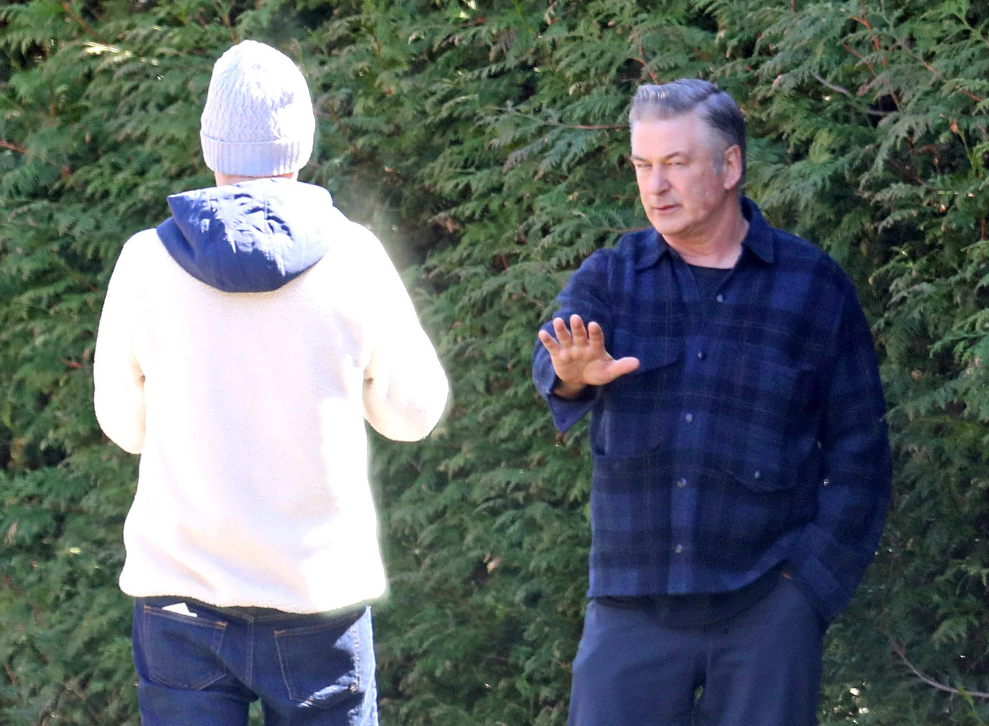Alec Baldwin keeps his distance while chatting with friends in the Hamptons during Coronavirus pandemic. The 61 year old actor made sure to practice social distancing by keeping the recommended six feet away from other people.