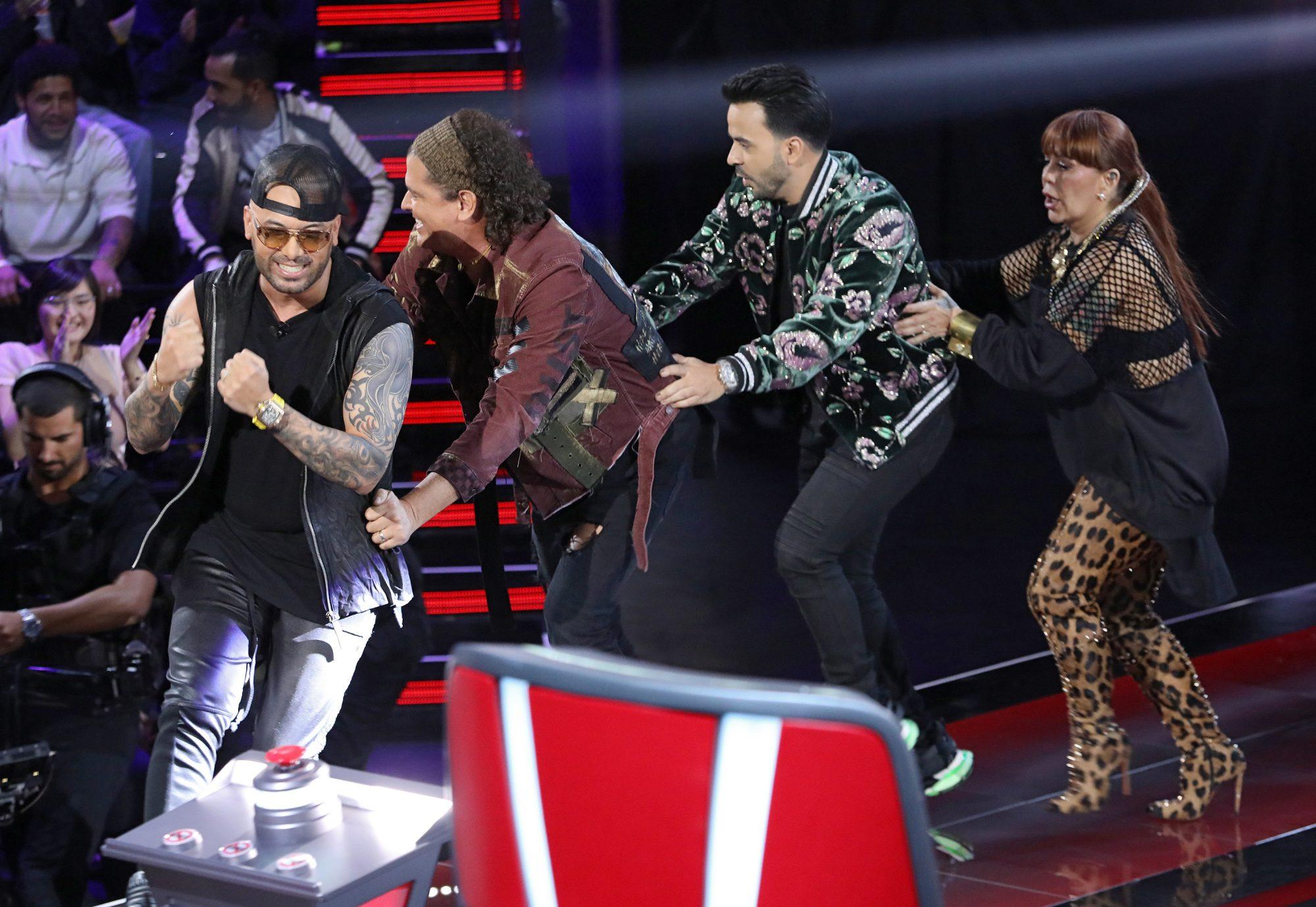 "Wisin, Carlos Vives, Luis Fonsi and Alejandra Guzman are seen celebrating on stage during Telemundo's ""La Voz"""